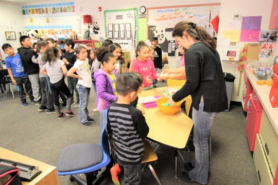 Students from the bi-lingual classes at Sierra Vista Primary enjoy 'Green Eggs' after  Dr. Bickert read to them teaching them life lessons.