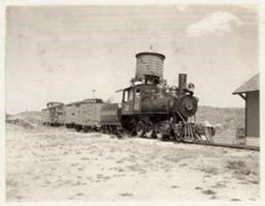 A train chugs into Capitan where coal was being mined.