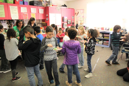 Green Eggs all about the classroom as the bi-lingual students at Sierra Vista Primary enjoy the tasty morsels after Dr. Bickert read 'Green Eggs and Ham' in both Spanish and English to them.