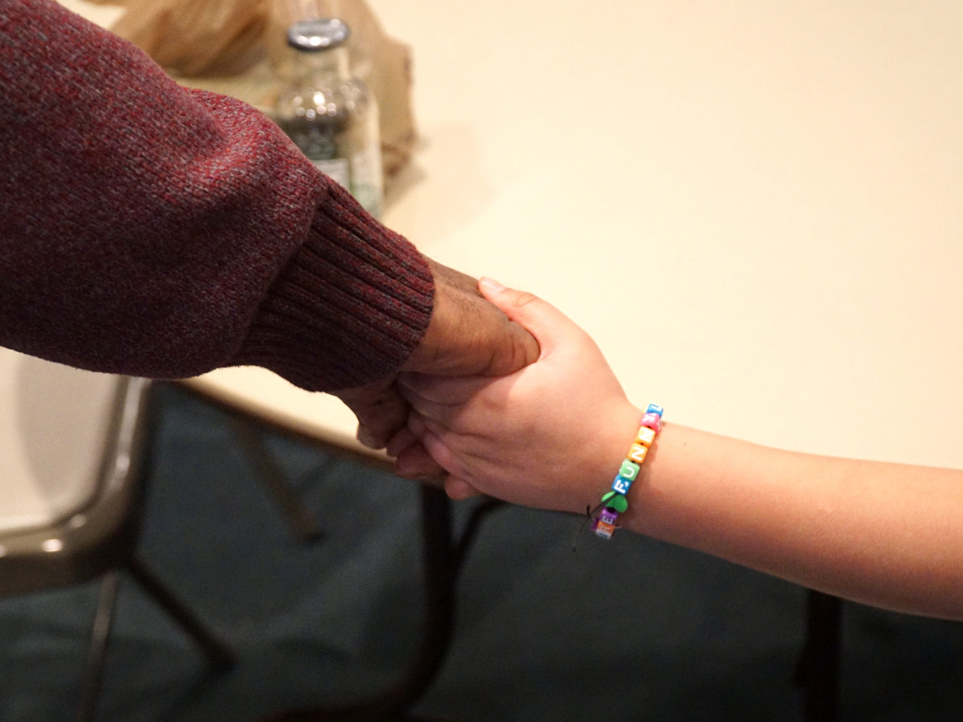 Actors involved in #Listen join hands before a rehearsal.