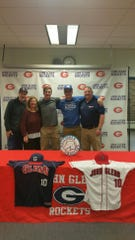 John Glenn senior Chad Stevens is honored with his family and coach after signing to play baseball at Hillsdale College.