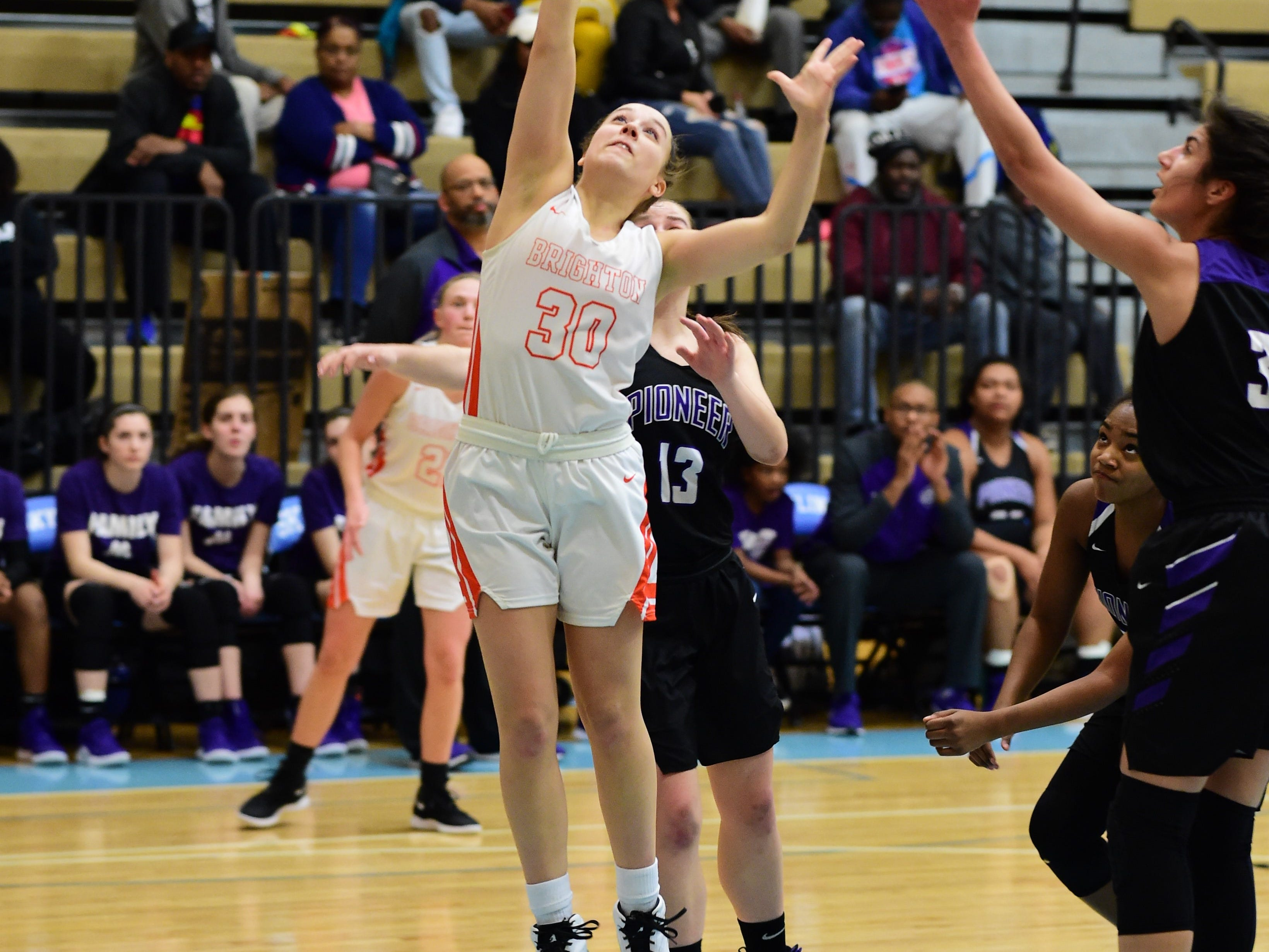 Brighton senior Lauren Brown goes up for a basket against Ann Arbor Pioneer on March 11, 2019.