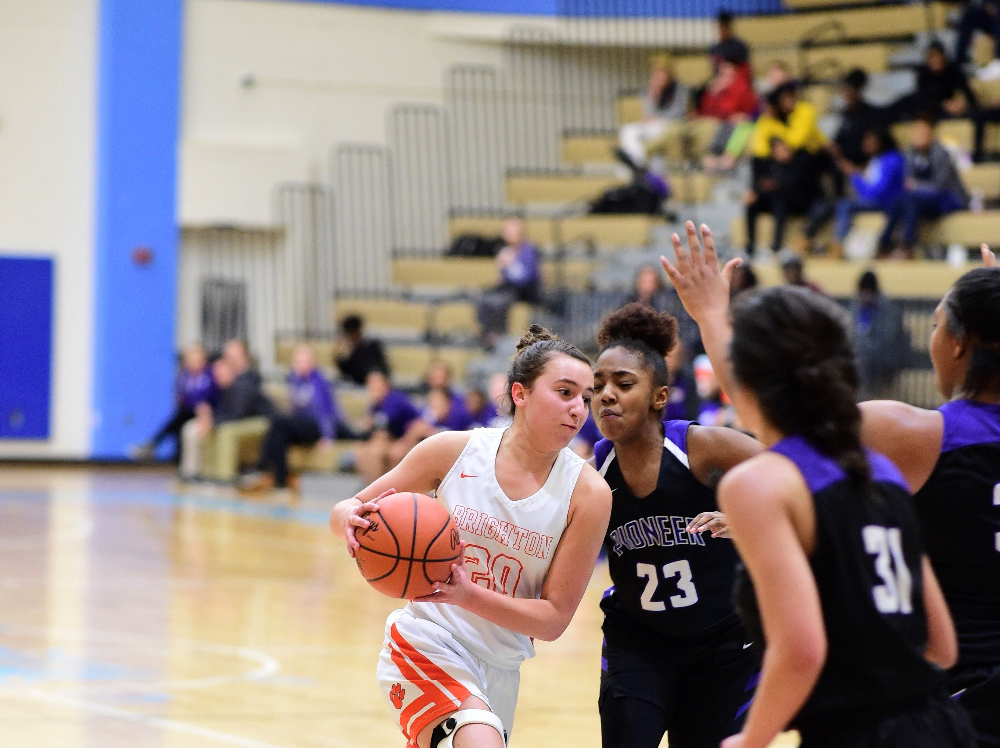 Brighton's Isabelle Viau drives to the hoop against Ann Arbor Pioneer on March 11, 2019.