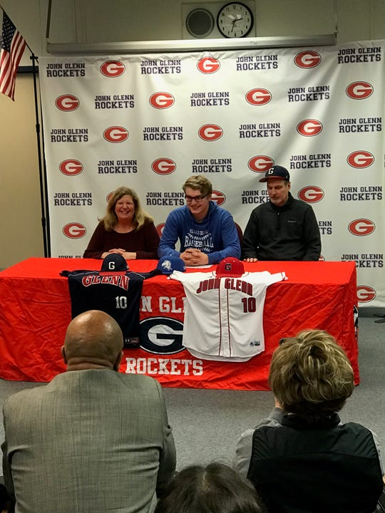 John Glenn senior Chad Stevens sits with his parents after signing to play baseball at Hillsdale.
