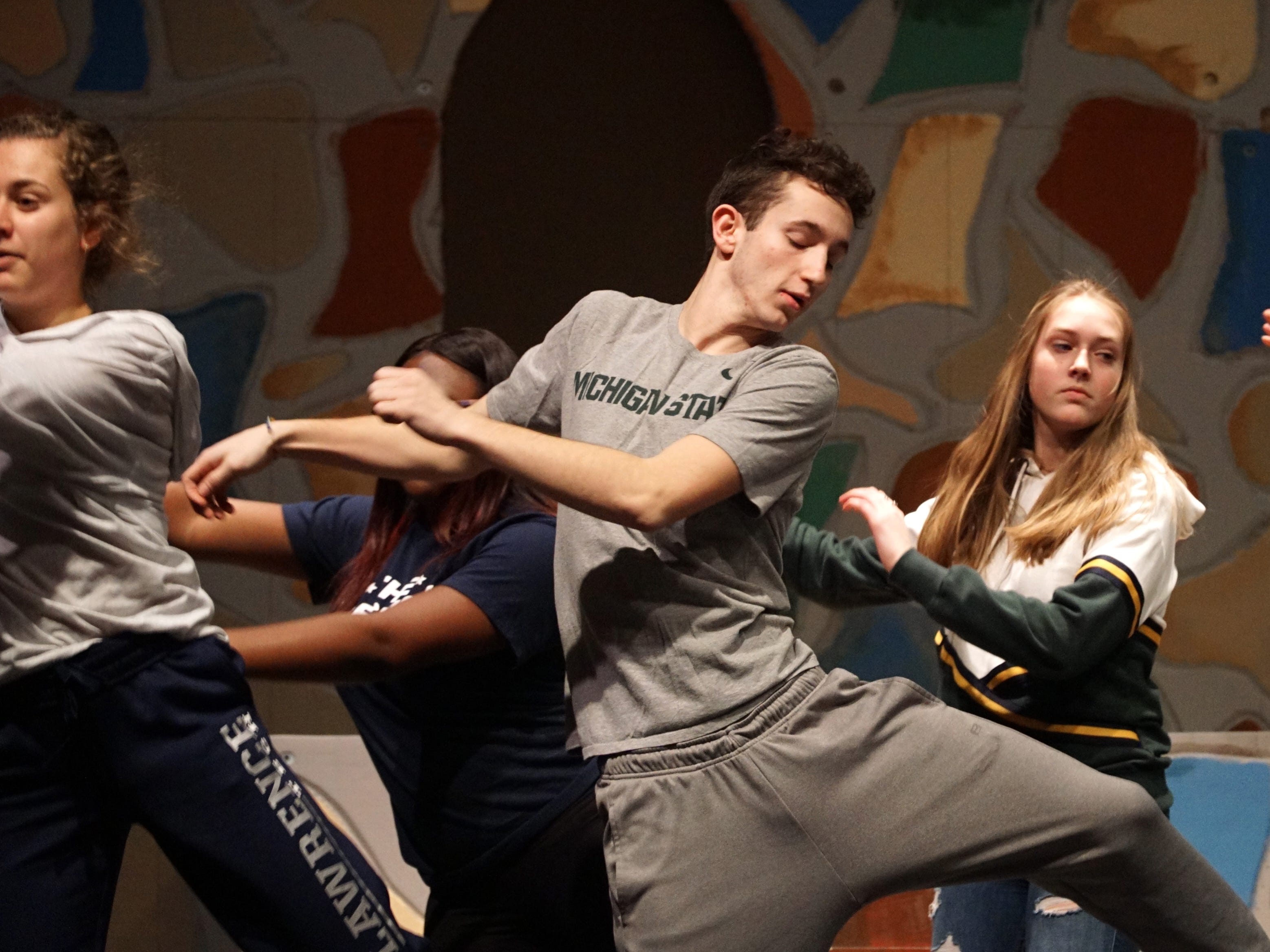 Sir Harry (Justin Bugeja), center,  performs a dance number with other students on March 11.