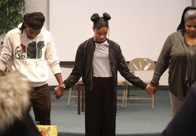 Andreana Beard joins hands with some of her cast before a recent rehearsal of #Listen at Farmington Hills' Hilltop Church of the Nazarene. At left is actor James Perkins and Andreana's mother Kimberley.