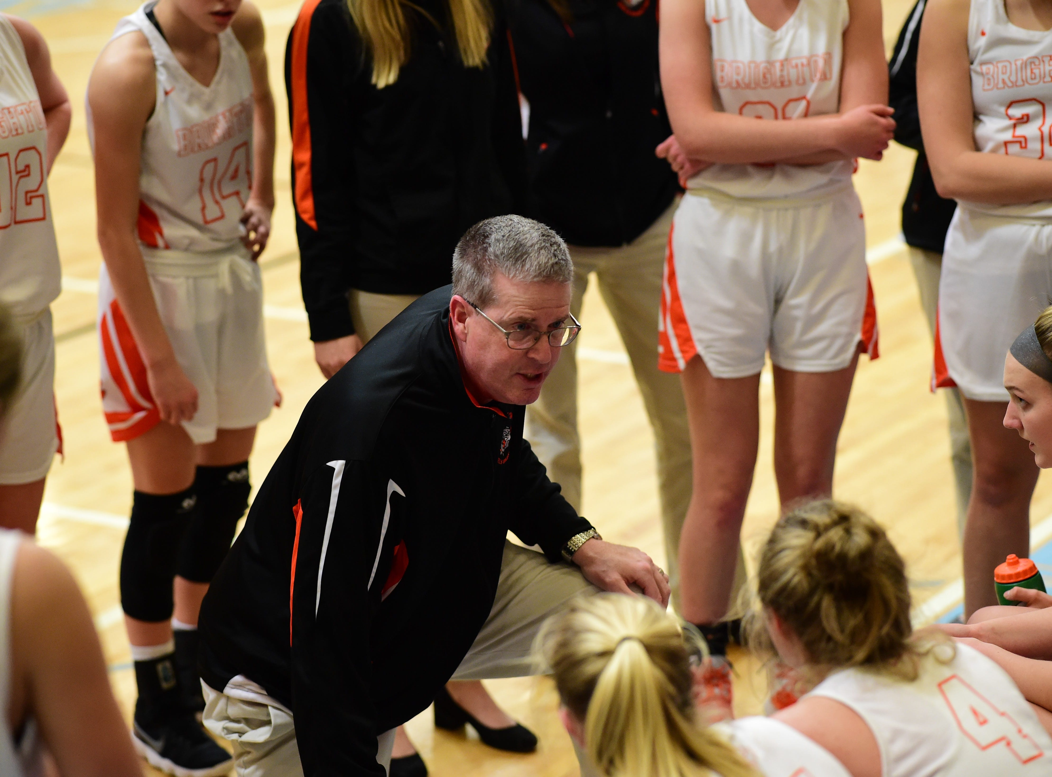 Brighton coach Paul Ash talks to his team during a timeout against Ann Arbor Pioneer on March 11, 2019.
