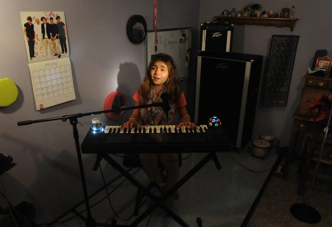 Franki Sakschek of was 11 when she was invited to trade the makeshift stage in her bedroom for one at Lambeau Field, where she performed at a Packers Family Night event in 2013.