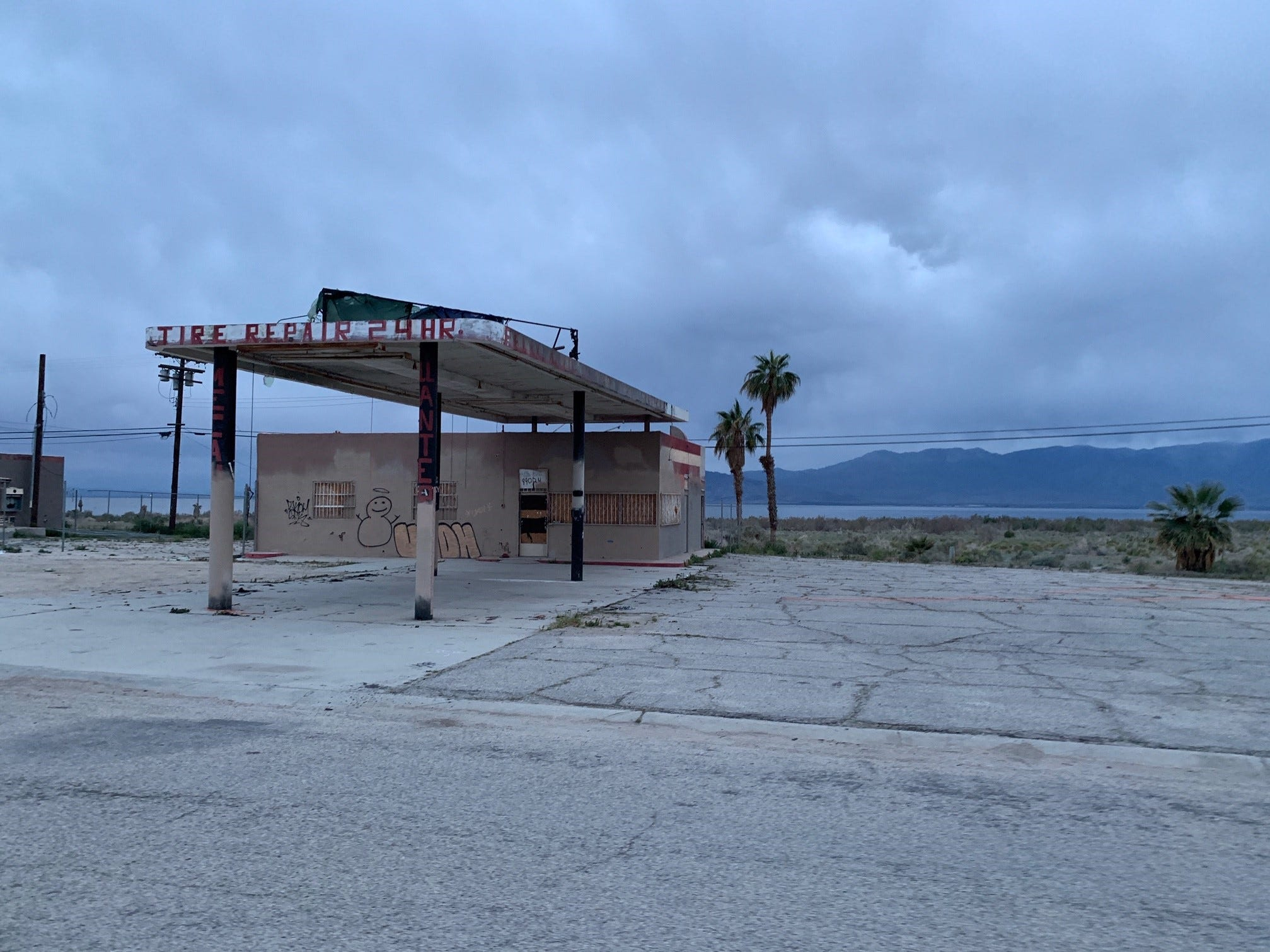 Artist Eric Mack's Desert X piece 'Halter' was once a collection of multi-colored fabric fastened to a derelict gas station at the shore of the Salton Sea, but the piece disappeared on March 11. Photo courtesy of Chris Taylor.