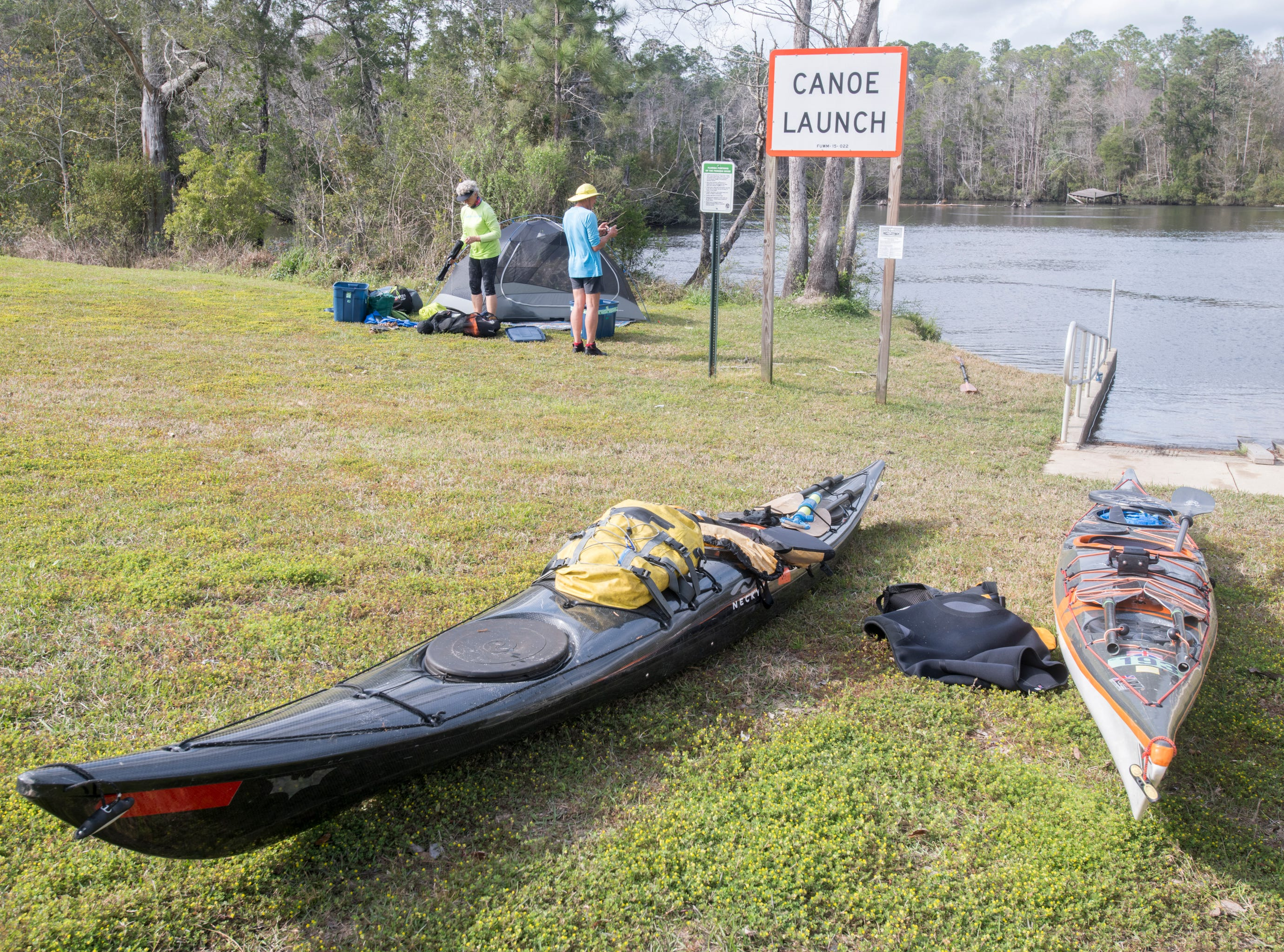 Debbie and Paul Gelderblom, of Charlevoix, Michigan, set up camp at the Wilson Robertson Boat Ramp on the Perdido River in Pensacola on Monday, March 11, 2019.  Paddle Florida is hosting 60 paddlers on a 5-day, 60-mile journey from Otto Hill to Perdido Pass.  Florida is currently working with Alabama to establish a paddling trail on the Perdido River.