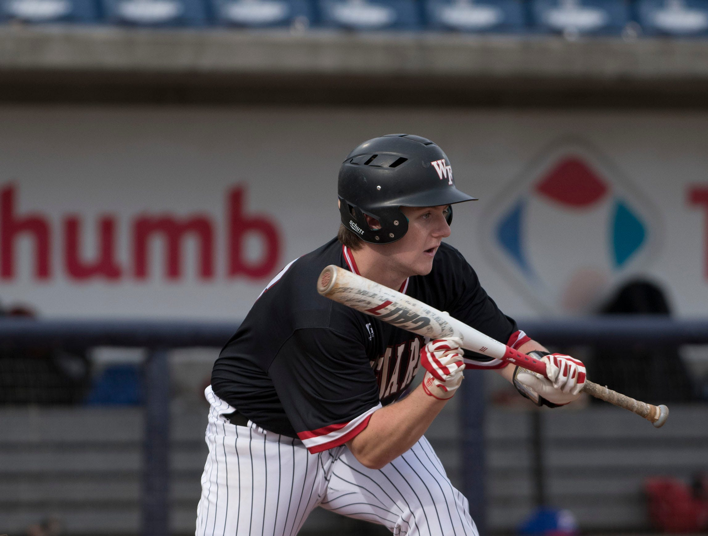 West Florida High School's Will Hackett,(No. 13) shows bunt against Pace High School during the Battle of the Bay tournament at Blue Wahoos stadium on Tuesday, March 12, 2019.