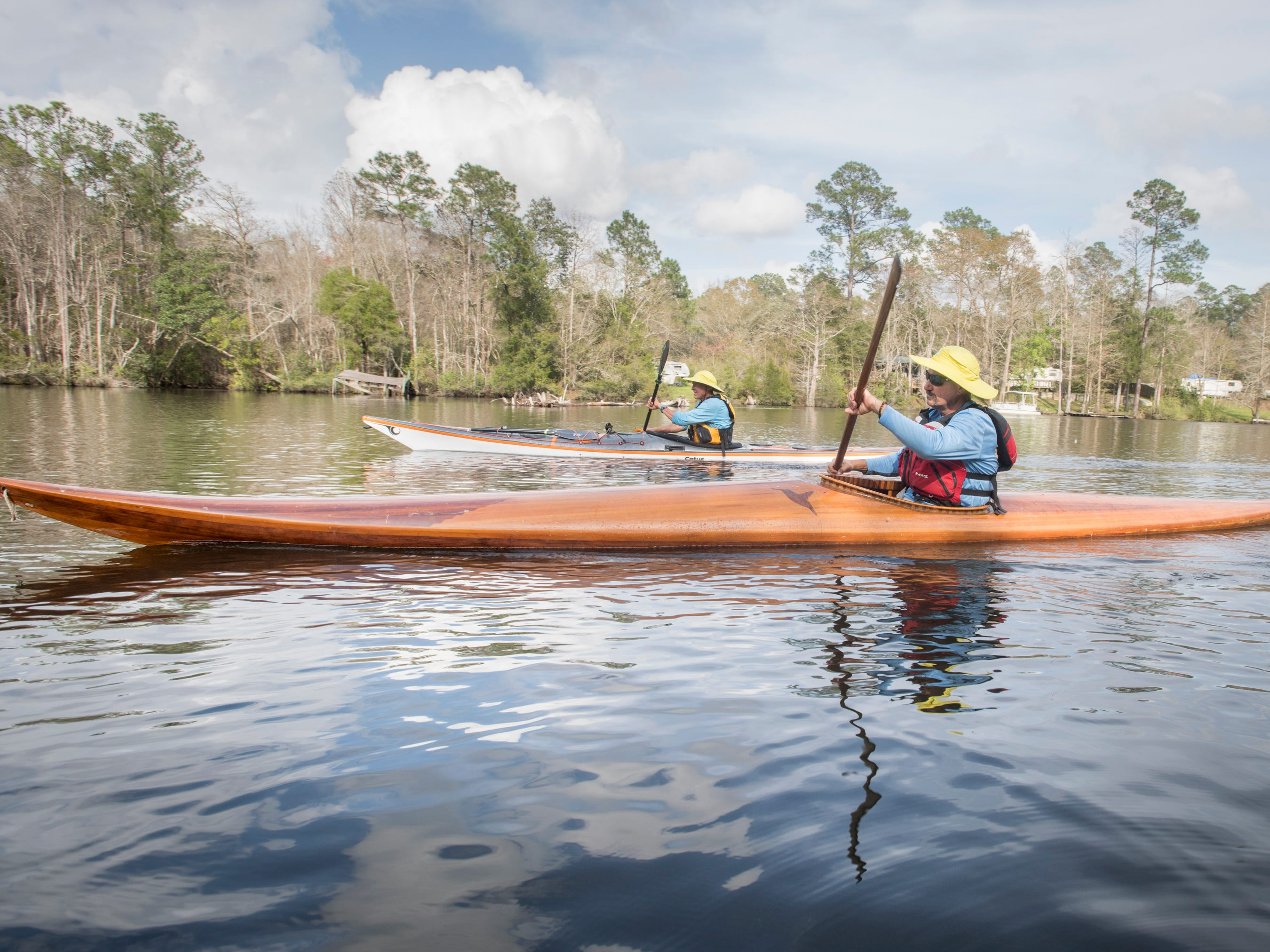Paul Gelderblom, of Charlevoix, Michigan, top, and Guerry Bradley, of St. Augustine, kayak on the Perdido River near the Wilson Robertson Boat Ramp in Pensacola on Monday, March 11, 2019.  Paddle Florida is hosting 60 paddlers on a 5-day, 60-mile journey from Otto Hill to Perdido Pass.  Florida is currently working with Alabama to establish a paddling trail on the Perdido River.