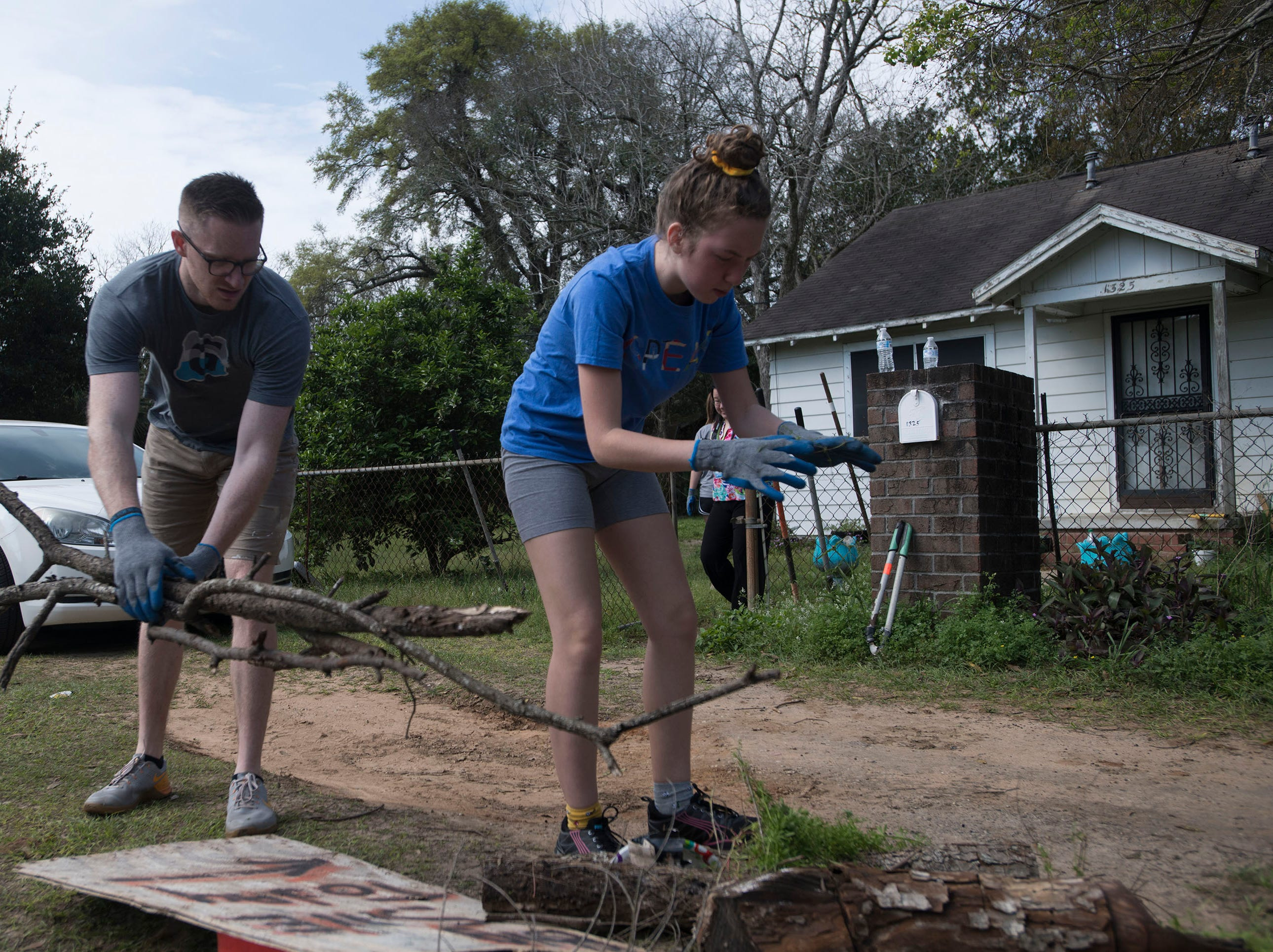Bo Banner, and Susannah Kaufman, with the organization Call to Greatness, volunteer their time cleaning up the Brownsville area on Tuesday, March 12, 2019. The local Habitat for Humanity, Keep Pensacola Beautiful the City of Pensacola and Escambia County joined forces to help revitalize the Brownsville neighborhood during the inaugural Rock the Block event.