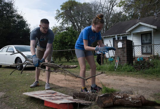 Bo Banner and Susannah Kaufman with the Kansas-based college ministry Called to Greatness work Tuesday to help clean up the Brownsville area as part of Rock the Block.