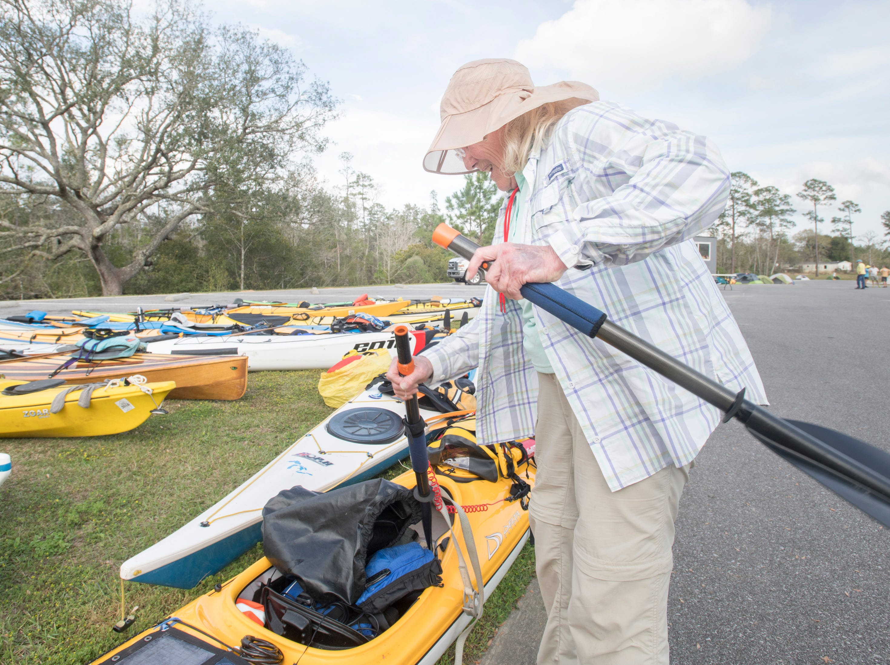 Diane Rickman-Buckalew stores her gear on her kayak at the Wilson Robertson Boat Ramp off the Perdido River in Pensacola on Monday, March 11, 2019.  Paddle Florida is hosting 60 paddlers on a 5-day, 60-mile journey from Otto Hill to Perdido Pass.  Florida is currently working with Alabama to establish a paddling trail on the Perdido River.