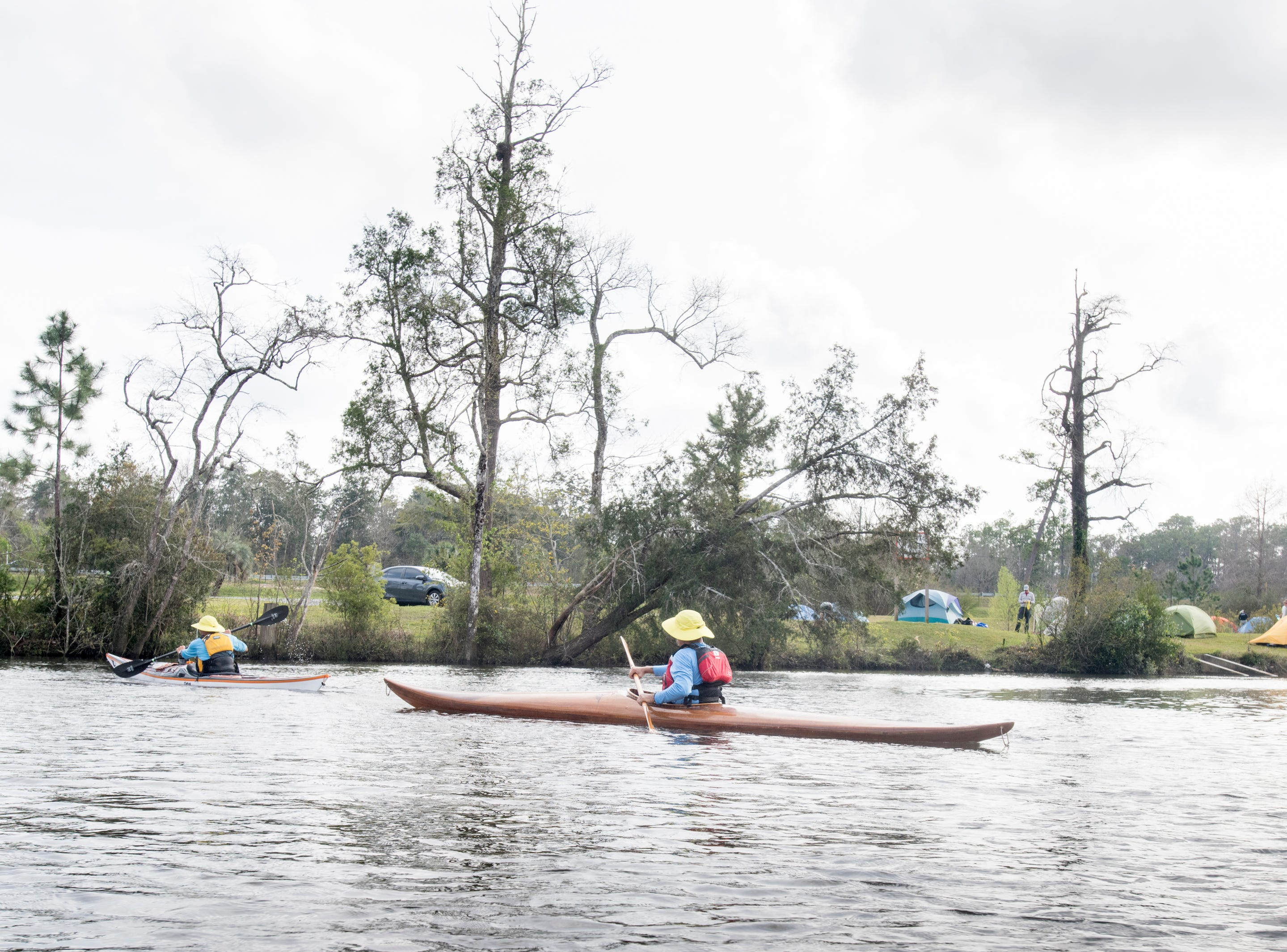 Paul Gelderblom, of Charlevoix, Michigan, left, and Guerry Bradley, of St. Augustine, make their way to shore at the Wilson Robertson Boat Ramp on the Perdido River in Pensacola on Monday, March 11, 2019.  Paddle Florida is hosting 60 paddlers on a 5-day, 60-mile journey from Otto Hill to Perdido Pass.  Florida is currently working with Alabama to establish a paddling trail on the Perdido River.