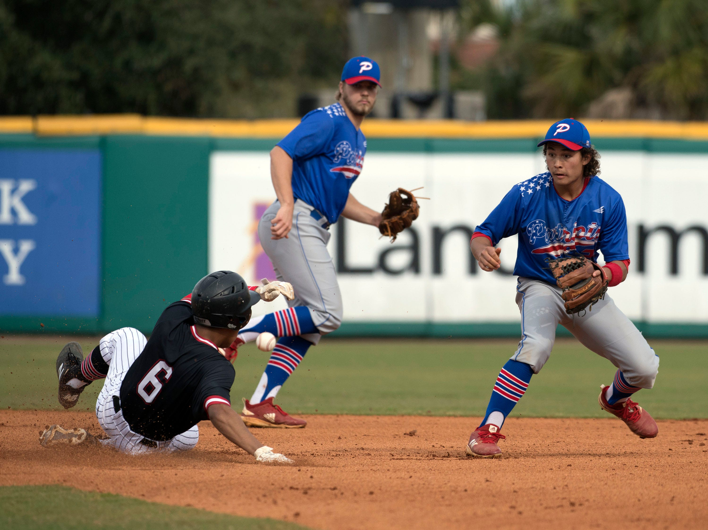 West Florida High School's Gavin Coles,(No. 6) takes second base as Pace High School's Caleb Vincent, (No. 24) and Aidan Gilroy, (No. 6) covers the bag during the Battle of the Bay tournament at Blue Wahoos stadium on Tuesday, March 12, 2019.