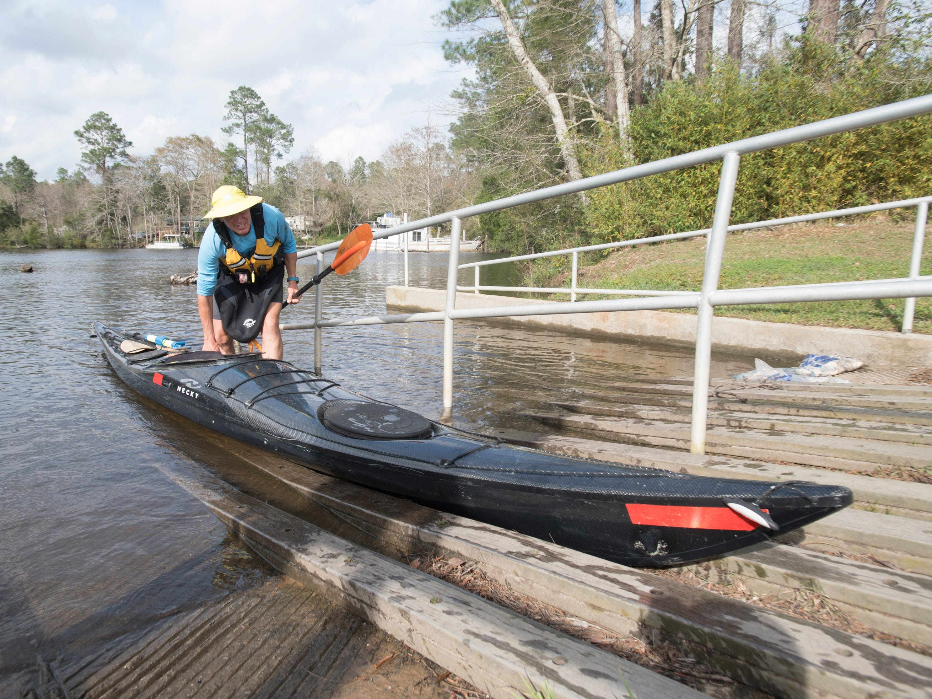 Paul Gelderblom, of Charlevoix, Michigan, removes his kayak at the Wilson Robertson Boat Ramp on the Perdido River in Pensacola on Monday, March 11, 2019.  Paddle Florida is hosting 60 paddlers on a 5-day, 60-mile journey from Otto Hill to Perdido Pass.  Florida is currently working with Alabama to establish a paddling trail on the Perdido River.