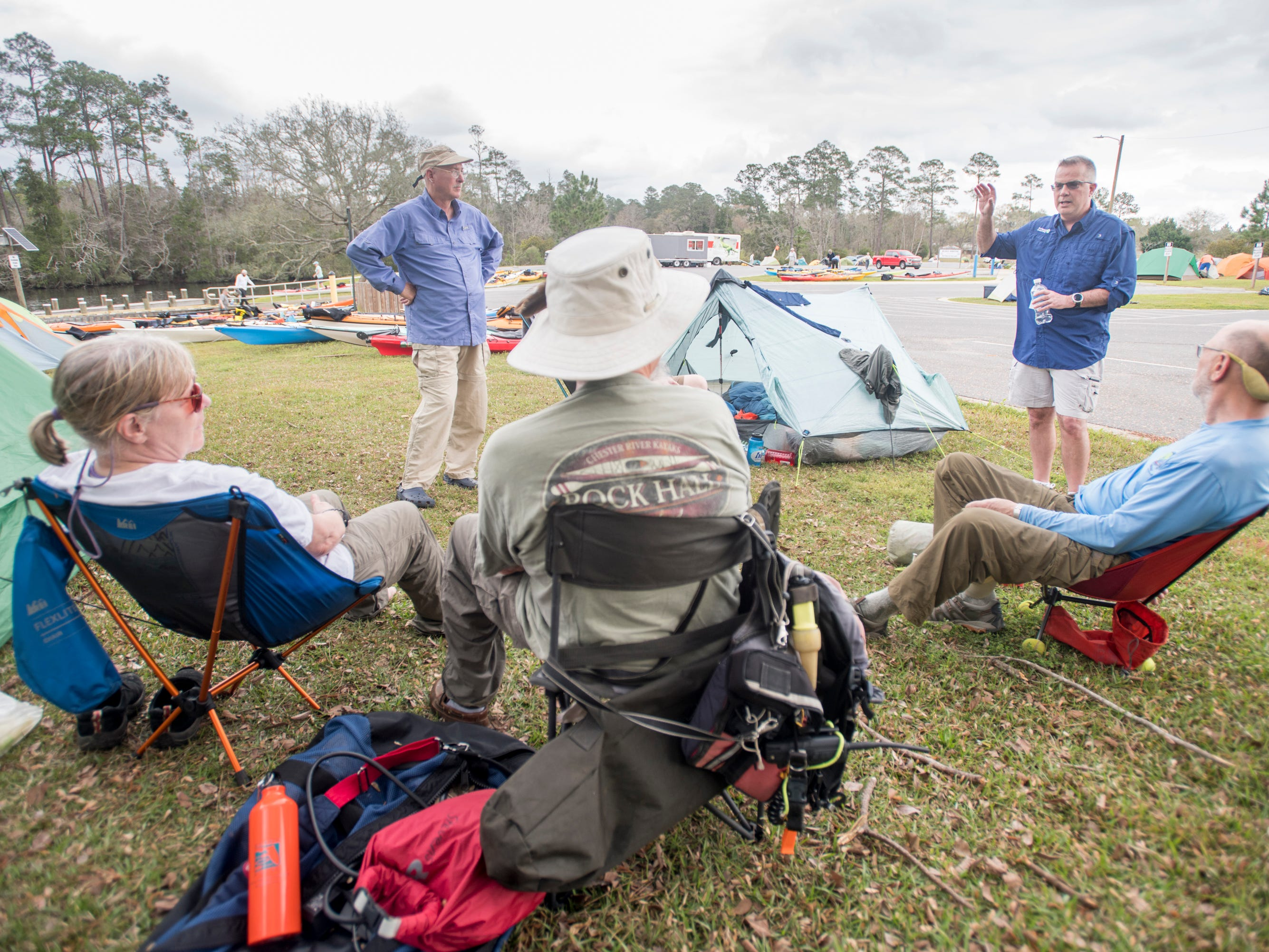 Darryl Boudreau, top right, chats with kayakers at the Wilson Robertson Boat Ramp on the Perdido River in Pensacola on Monday, March 11, 2019.  Paddle Florida is hosting 60 paddlers on a 5-day, 60-mile journey from Otto Hill to Perdido Pass.  Florida is currently working with Alabama to establish a paddling trail on the Perdido River.