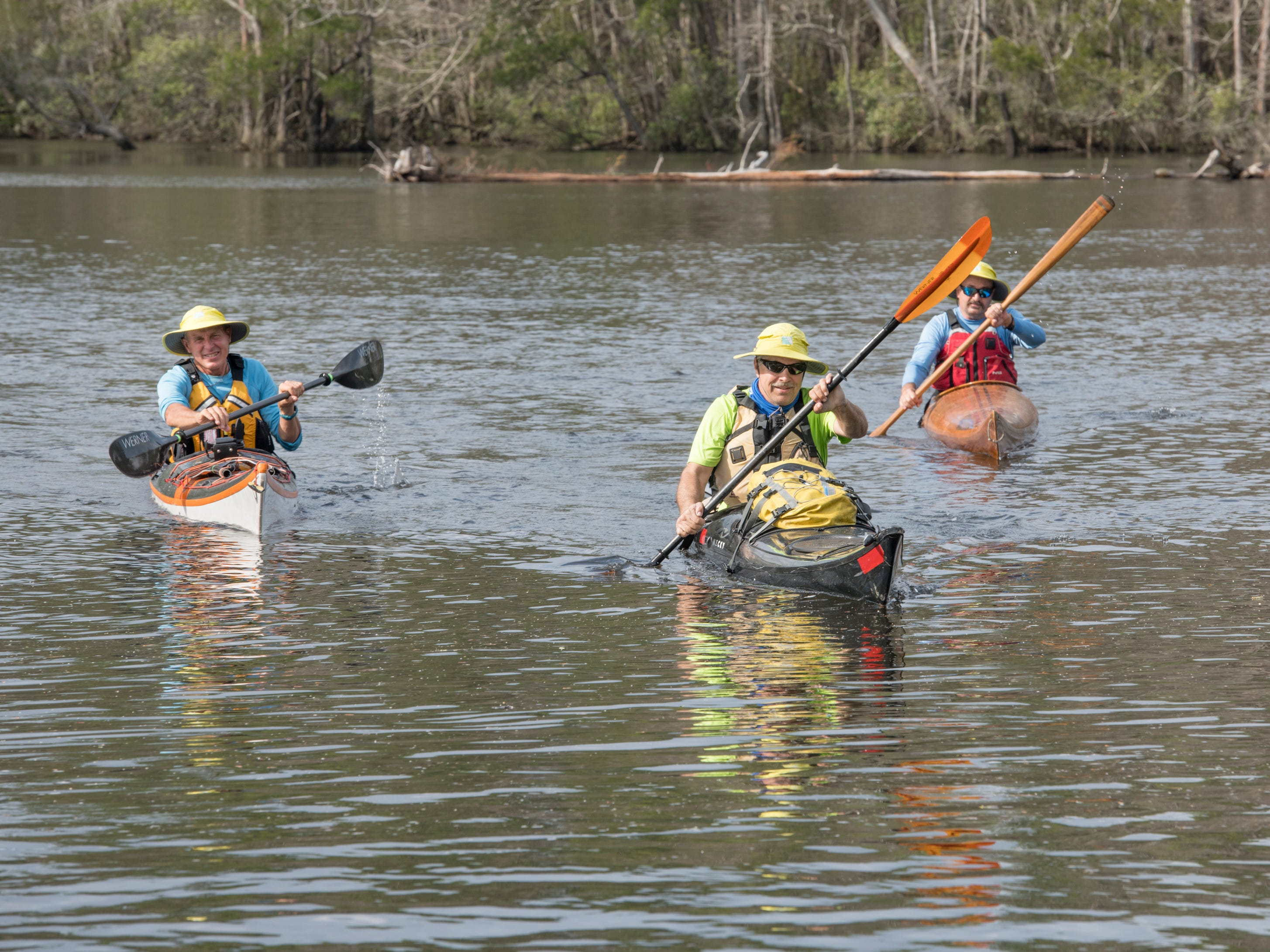 Paul Gelderblom, of Charlevoix, Michigan, from left, Doug Alderson, of Tallahassee, and Guerry Bradley, of St. Augustine, kayak on the Perdido River near the Wilson Robertson Boat Ramp in Pensacola on Monday, March 11, 2019.  Paddle Florida is hosting 60 paddlers on a 5-day, 60-mile journey from Otto Hill to Perdido Pass.  Florida is currently working with Alabama to establish a paddling trail on the Perdido River.