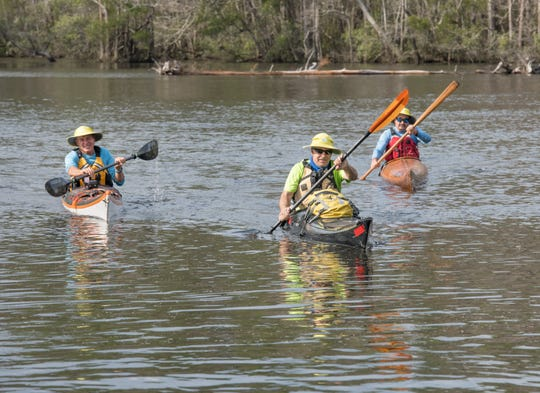 From left, Paul Gelderblom, of Charlevoix, Michigan, Doug Alderson, of Tallahassee, and Guerry Bradley, of St. Augustine, kayak on the Perdido River near the Wilson Robertson Boat Ramp in Pensacola on Monday.