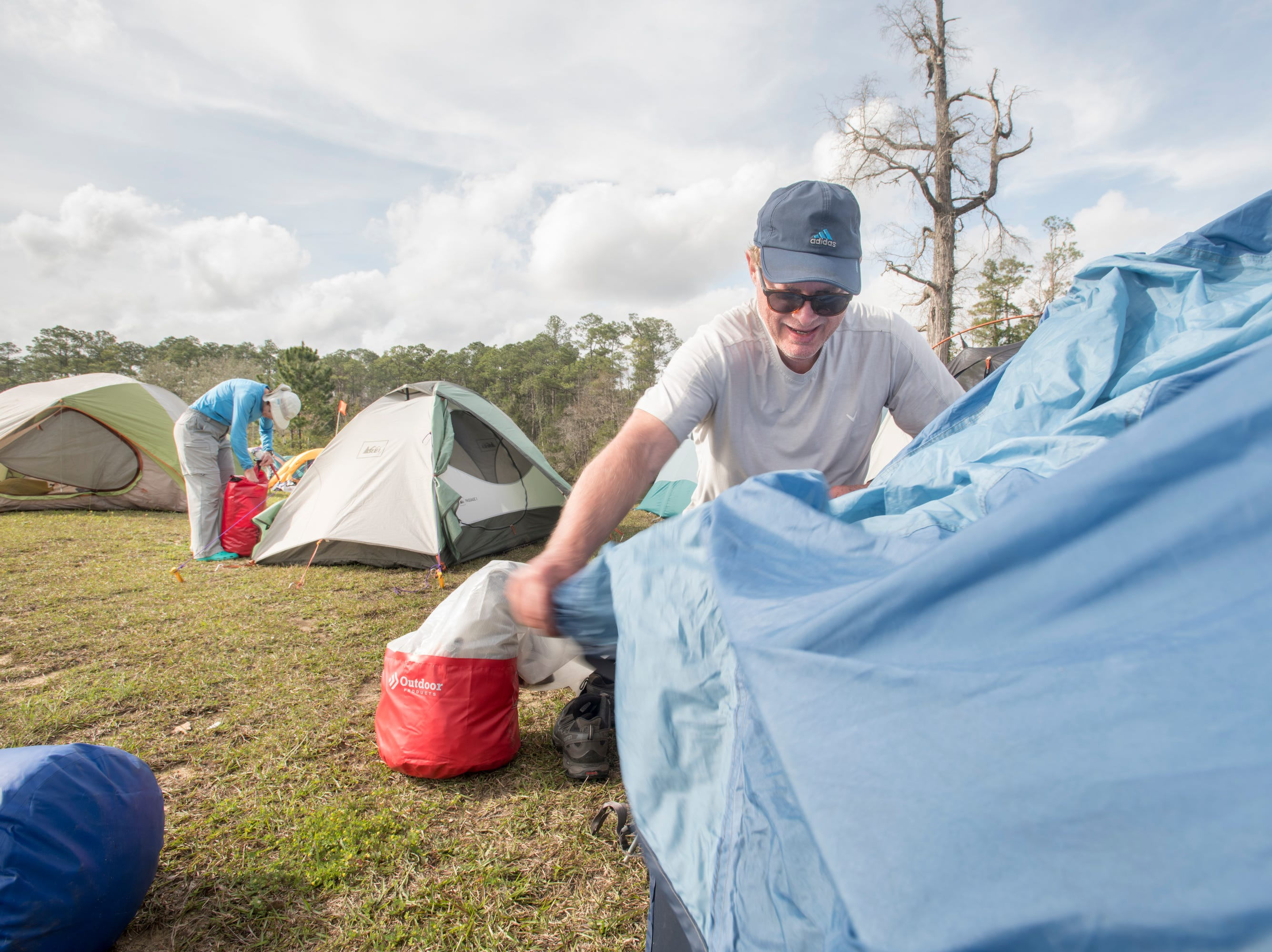 Jeff Wallace, of Fairhope, Alabama sets up his tent at the Wilson Robertson Boat Ramp off the Perdido River in Pensacola on Monday, March 11, 2019.  Paddle Florida is hosting 60 paddlers on a 5-day, 60-mile journey from Otto Hill to Perdido Pass.  Florida is currently working with Alabama to establish a paddling trail on the Perdido River.