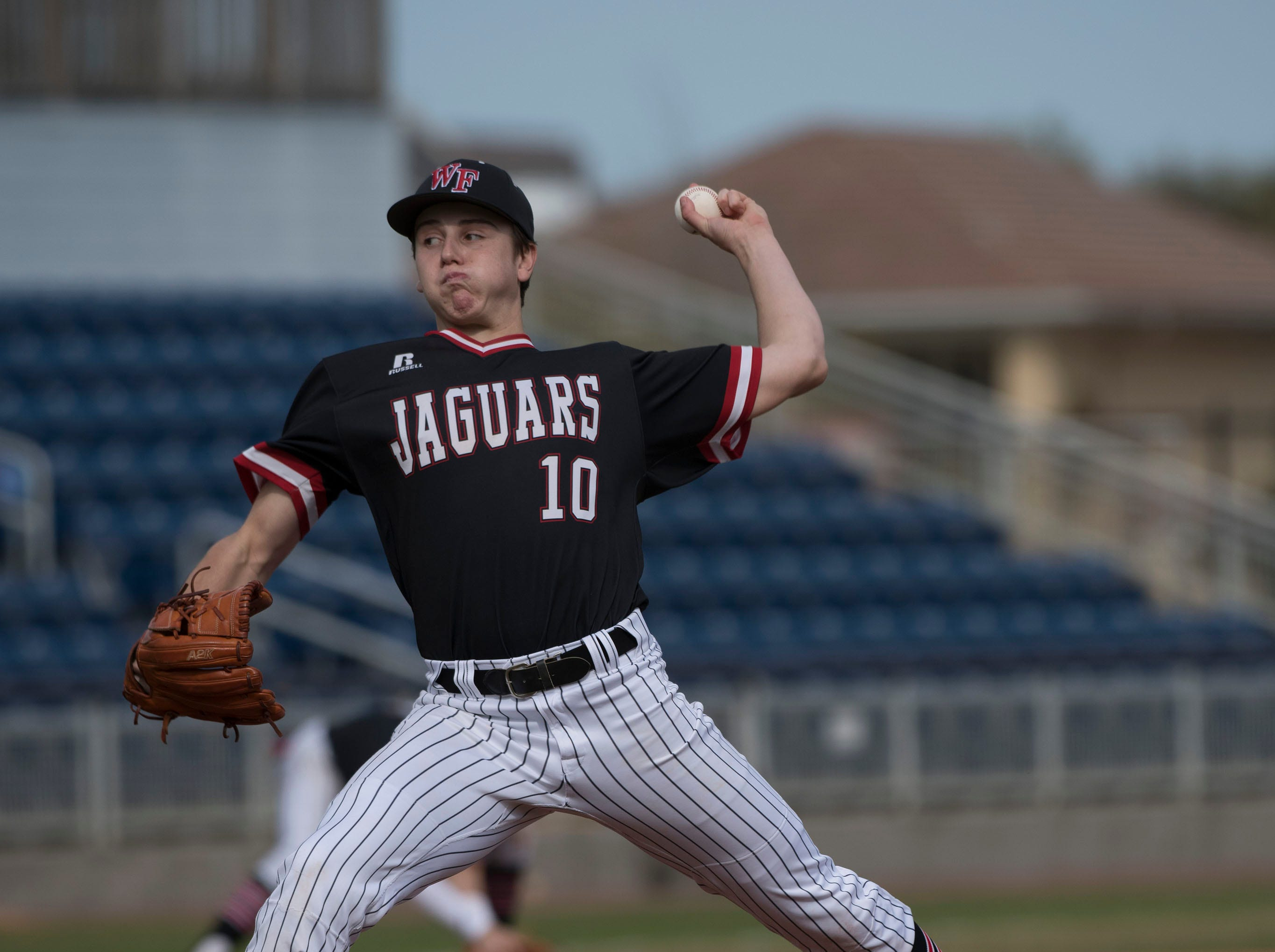 West Florida High School's pitcher, Graham Holland, (No. 10) gets off to a rocky start against Pace High School during the opening game of the Battle of the Bay baseball tournament at Blue Wahoos Stadium on Tuesday, March 12, 2019.