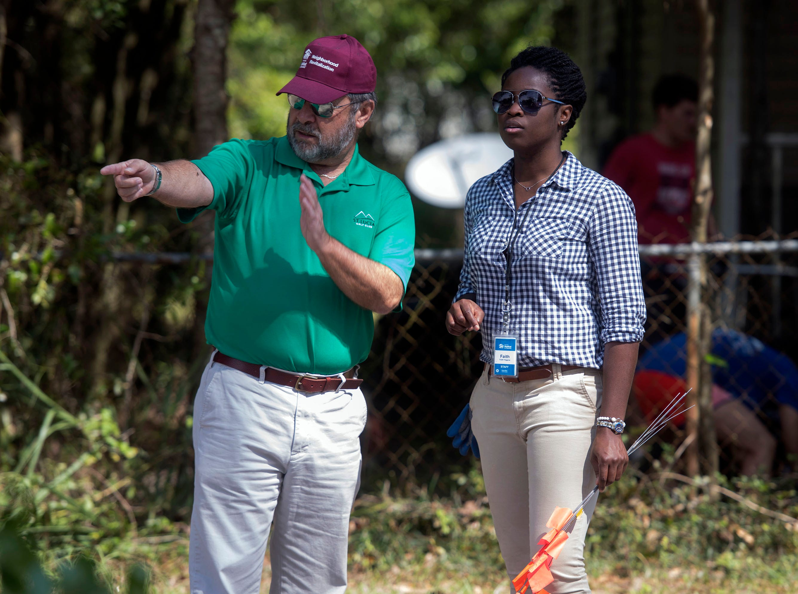 Joe Ocobock and Faith Higgins of Habitat for Humanity of Pensacola work with Keep Pensacola Beautiful, volunteers from Call to Greatness, the City of Pensacola and Escambia County to help revitalize the Brownsville area during the inaugural Rock the Block event on Tuesday, March 12, 2019.