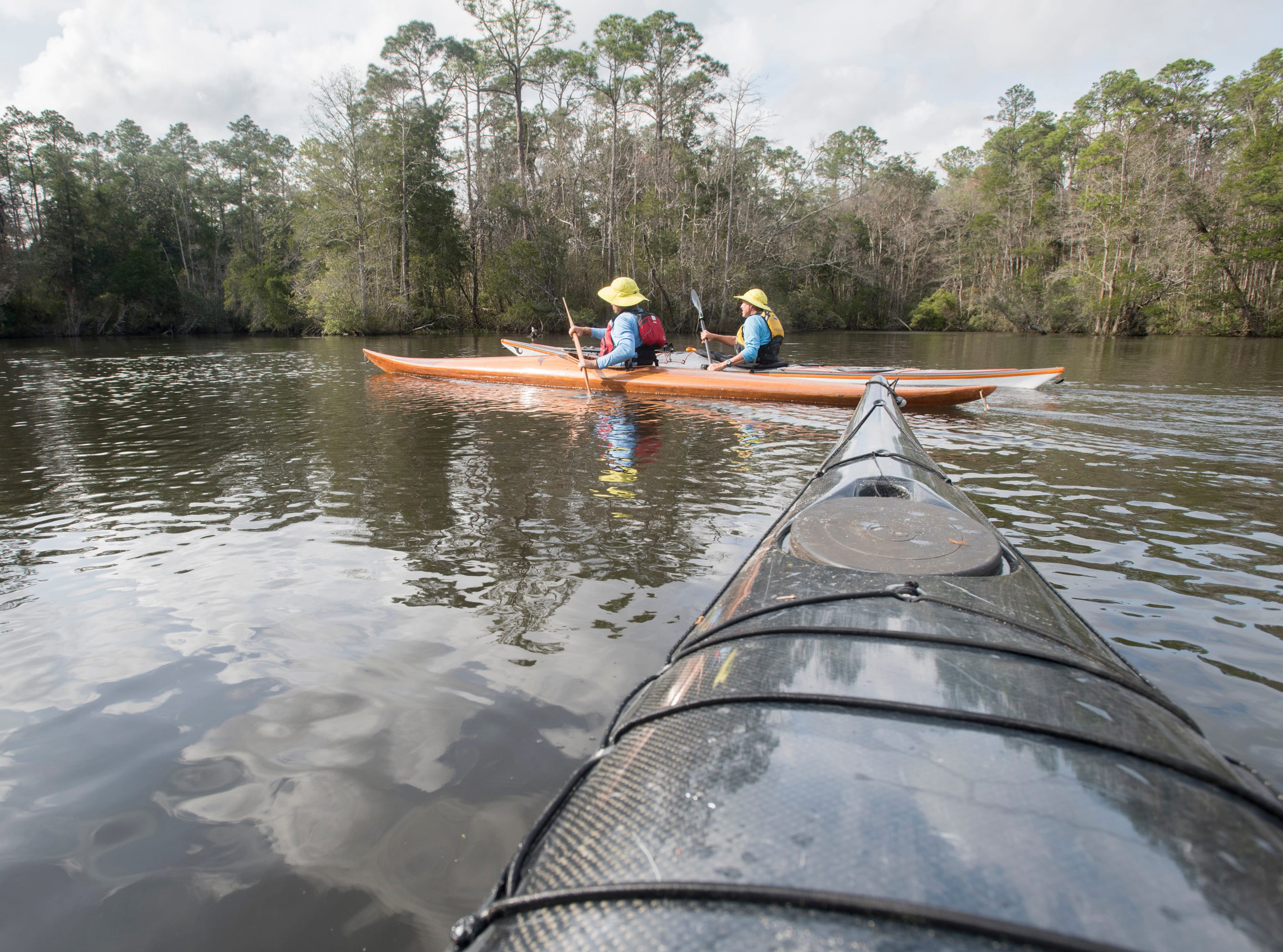 Guerry Bradley, of St. Augustine, left, and Paul Gelderblom, of Charlevoix, Michigan, kayak on the Perdido River near the Wilson Robertson Boat Ramp in Pensacola on Monday, March 11, 2019.  Paddle Florida is hosting 60 paddlers on a 5-day, 60-mile journey from Otto Hill to Perdido Pass.  Florida is currently working with Alabama to establish a paddling trail on the Perdido River.