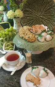 Looking for a different way to celebrate St. Patrick's Day this year? Try throwing an Irish tea party, complete with Irish cheddar scones, shamrock cookies, basil and pistachio cookies and white chocolate covered strawberries.