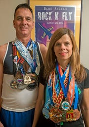 Shannon and Mike Kohler of Pensacola are preparing to run in a marathon on every continent.