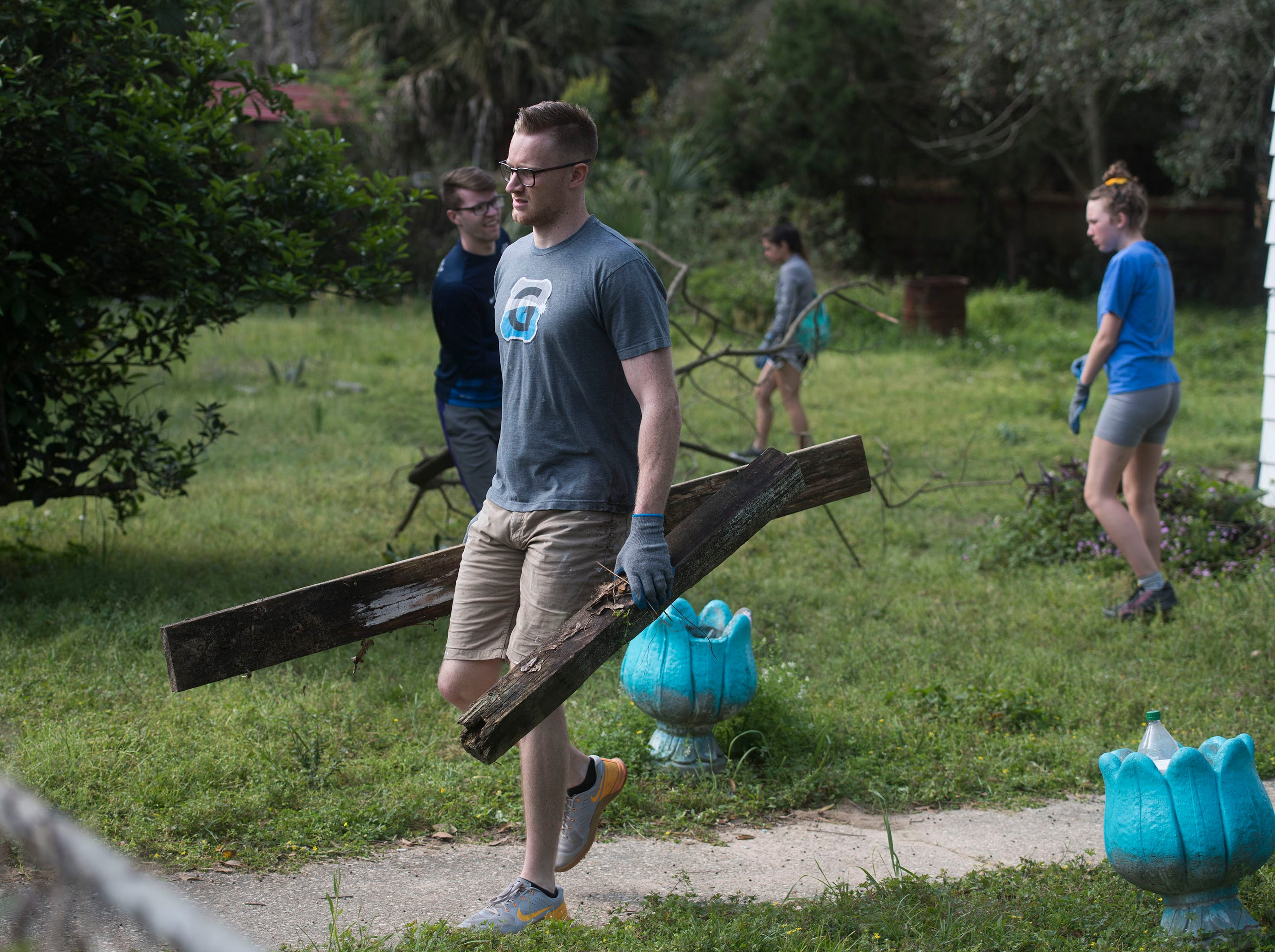 Bo Banner, with the organization Call to Greatness, volunteers his time cleaning up the Brownsville area on Tuesday, March 12, 2019. The local Habitat for Humanity, Keep Pensacola Beautiful the City of Pensacola and Escambia County joined forces to help the Brownsville neighborhood for the inaugural Rock the Block event. The local Habitat for Humanity, Keep Pensacola Beautiful the City of Pensacola and Escambia County joined forces to help revitalize the Brownsville neighborhood during the inaugural Rock the Block event.