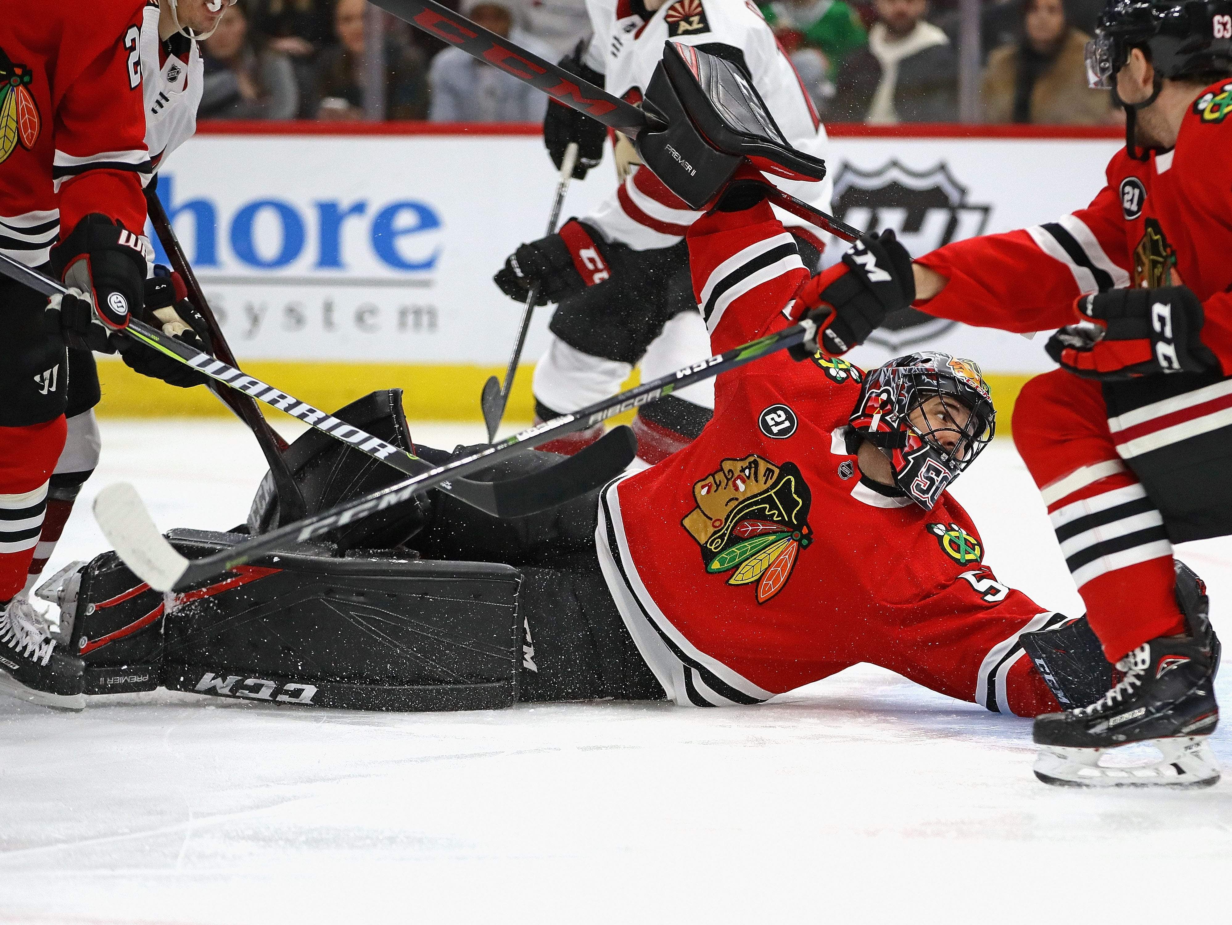 Blackhawks goaltender Corey Crawford looks into the net as a shot by Richard Panik slides in for a score on March 11 at the United Center.
