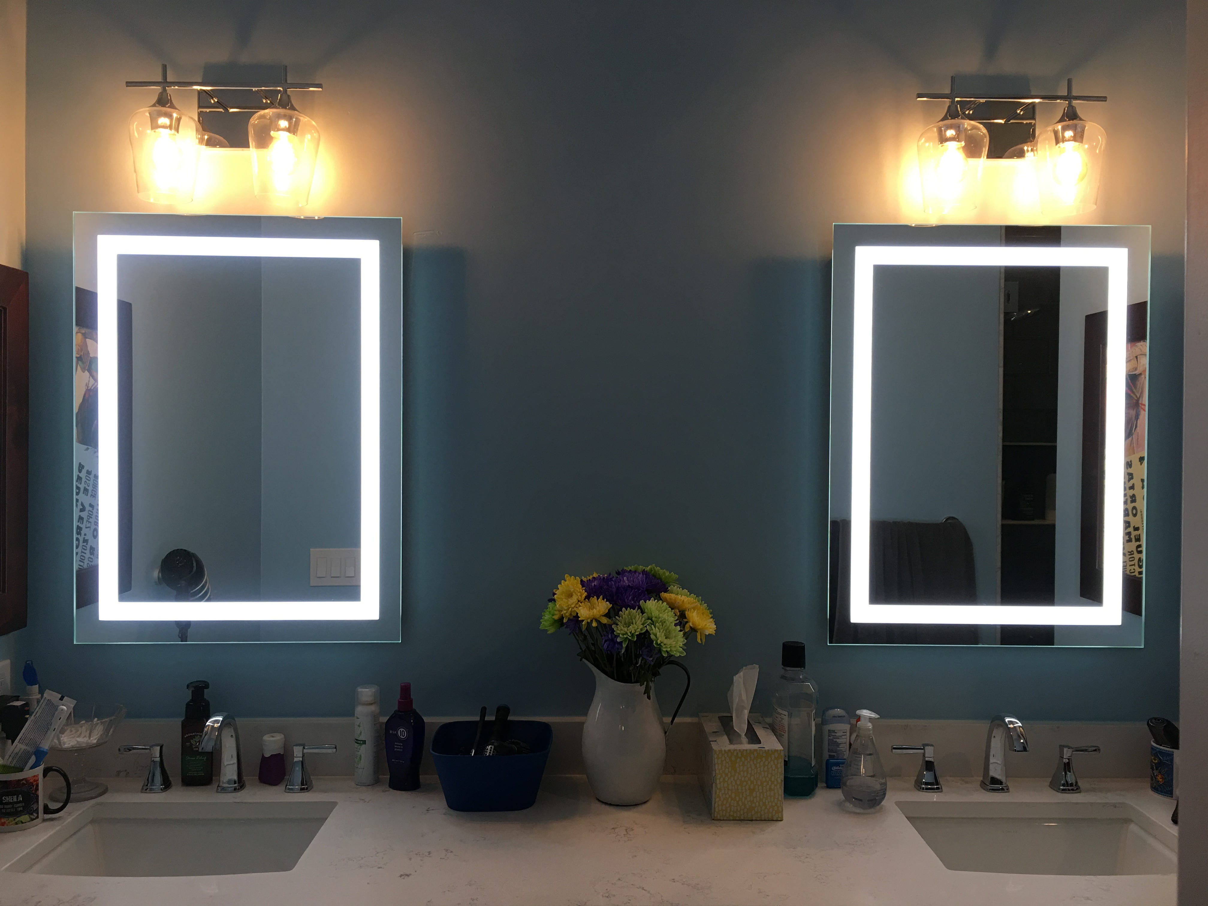 The master bathroom features dual sinks and lighted mirrors.