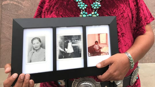 Debbie Nez Manuel holds a frame with photos of her mother Frances Tsinajinnie. Her mother went missing 1973 in a boarder town near the Navajo Nation. She was eventually found and buried by her family. Manuel shared her story about her mother in support of HB2570.