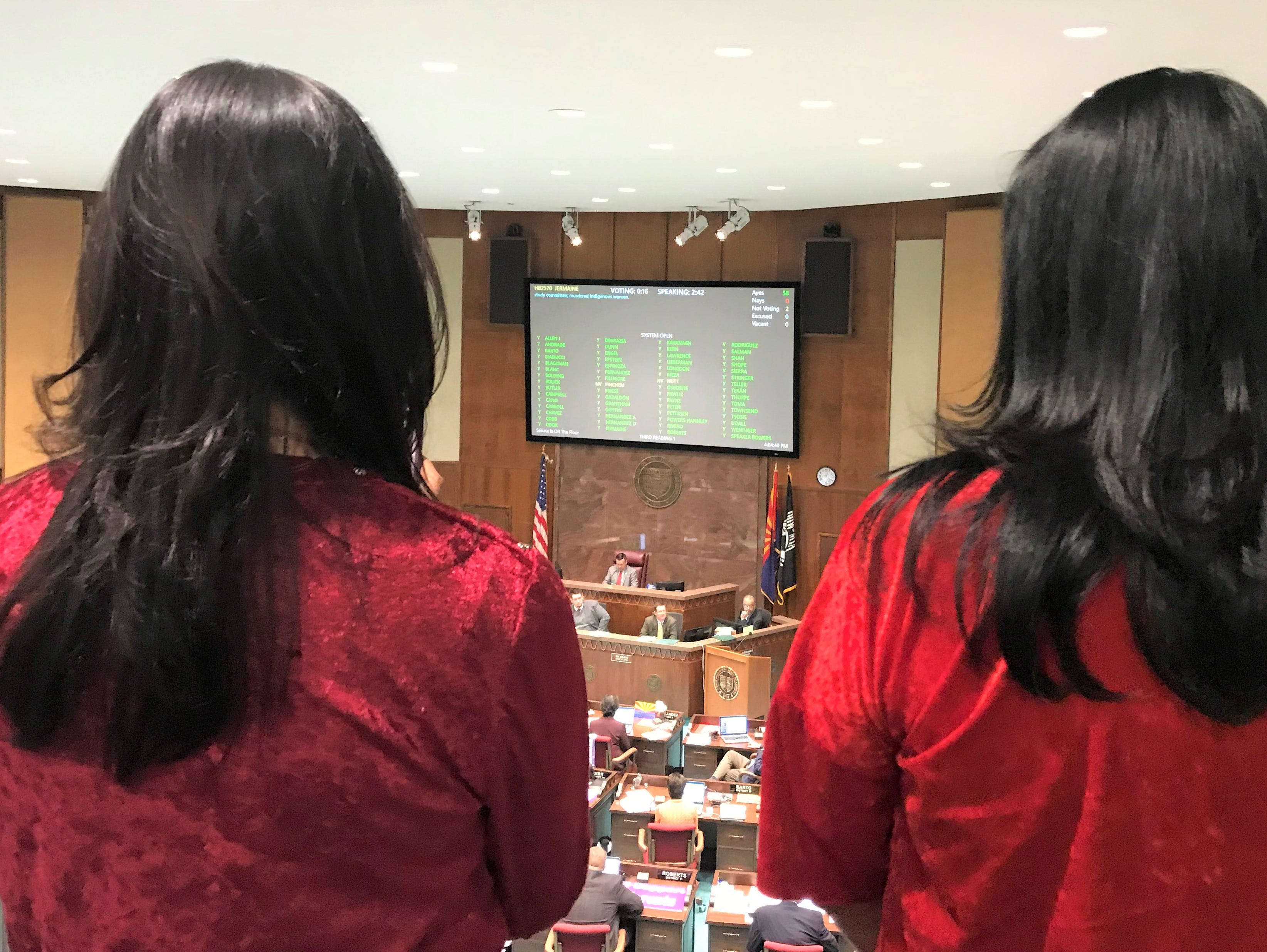 Navajo Nation First Lady Phefelia Nez (left) and Second Lady Dottie Lizer watch the votes come in for HB2570, a bill to create a study committee dedicated to missing and murdered indigenous women and girls. The bill passed 60-0 and is headed to the senate.