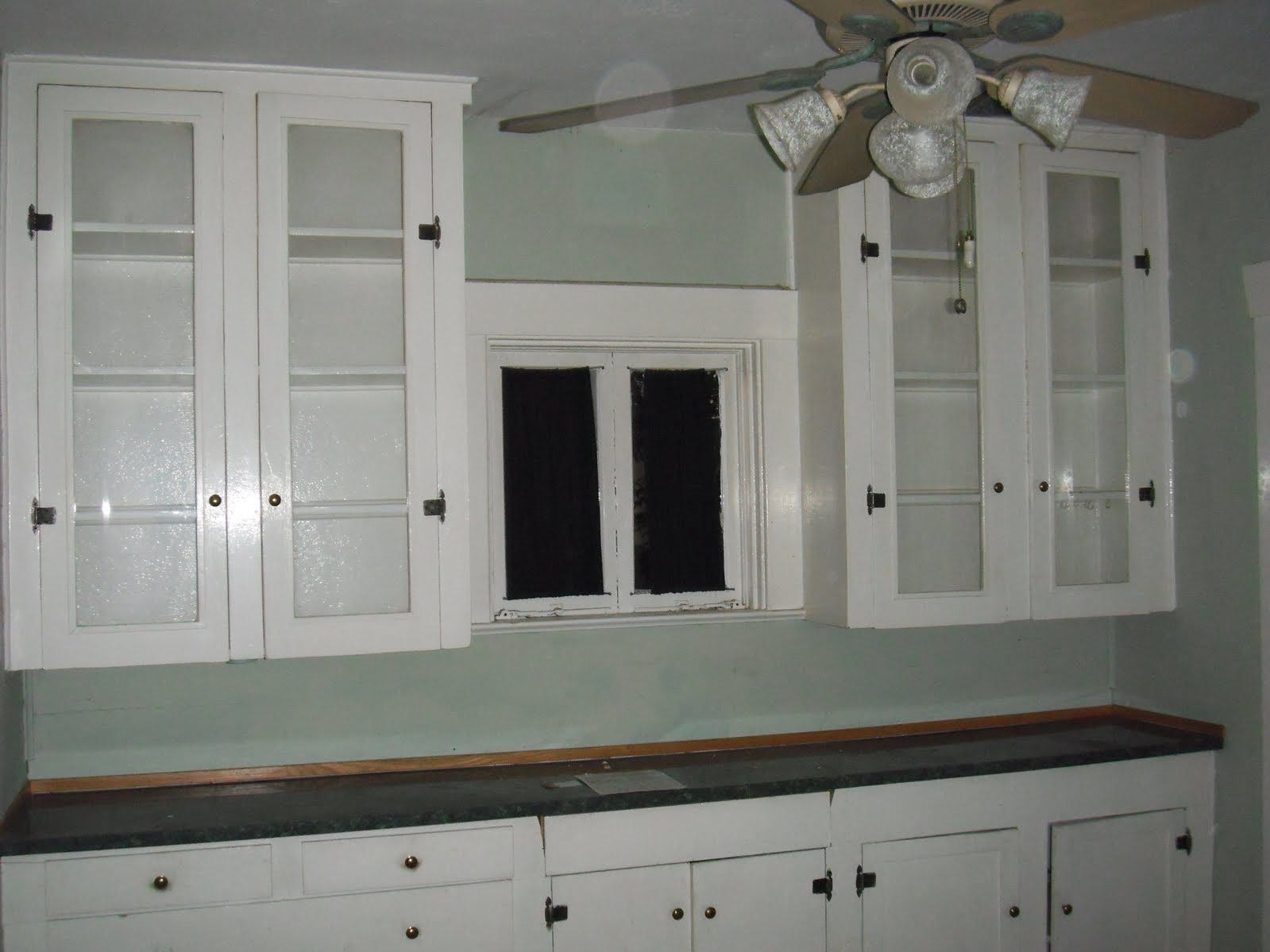 2010 picture of original kitchen cabinets (now dining room).