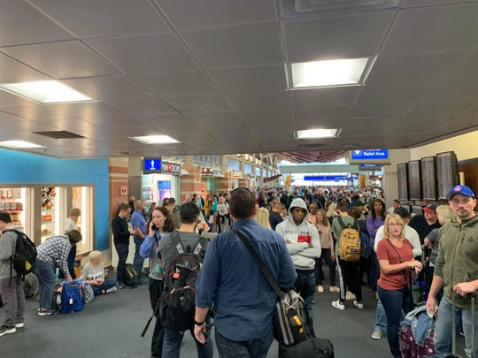 People crowded Concourse D in Phoenix Sky Harbor International Airport's Terminal 4 on March 12, 2019.