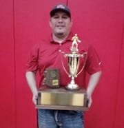 Santa Cruz Valley wrestling coach Ray Belloc holds up a trophy