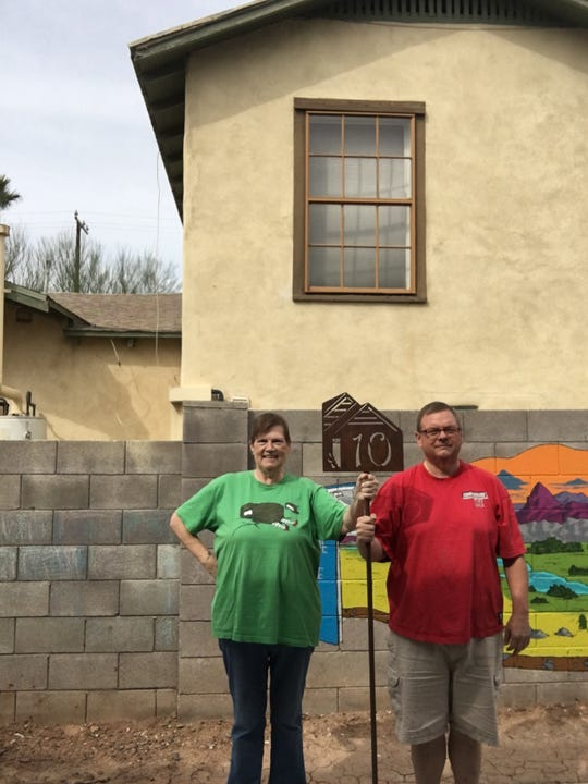 Sheila Krueger and Paul Hennings pose with the sign that was used to mark their house on the 2019 Coronado Historically Modern Homes Tour, the 32nd annual tour of the neighborhood.