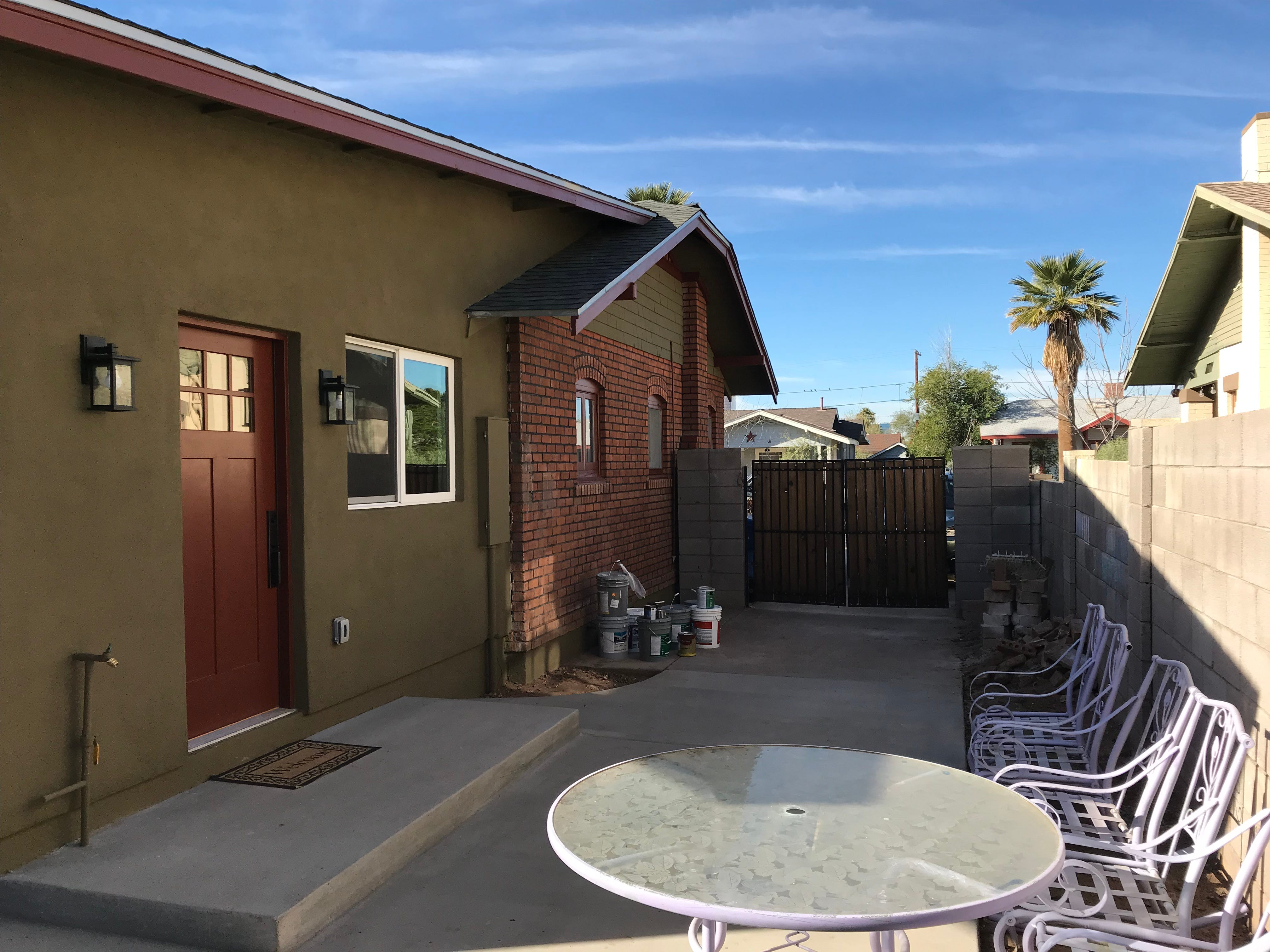 The kitchen door leads to a large patio area for outdoor living.