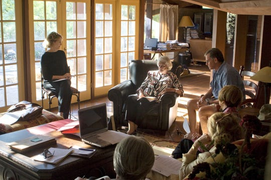 Sandra Day O'Connor (center) and her friends gather in her former home about the fate of the adobe home. The home was relocated brick by brick to Papago Park.