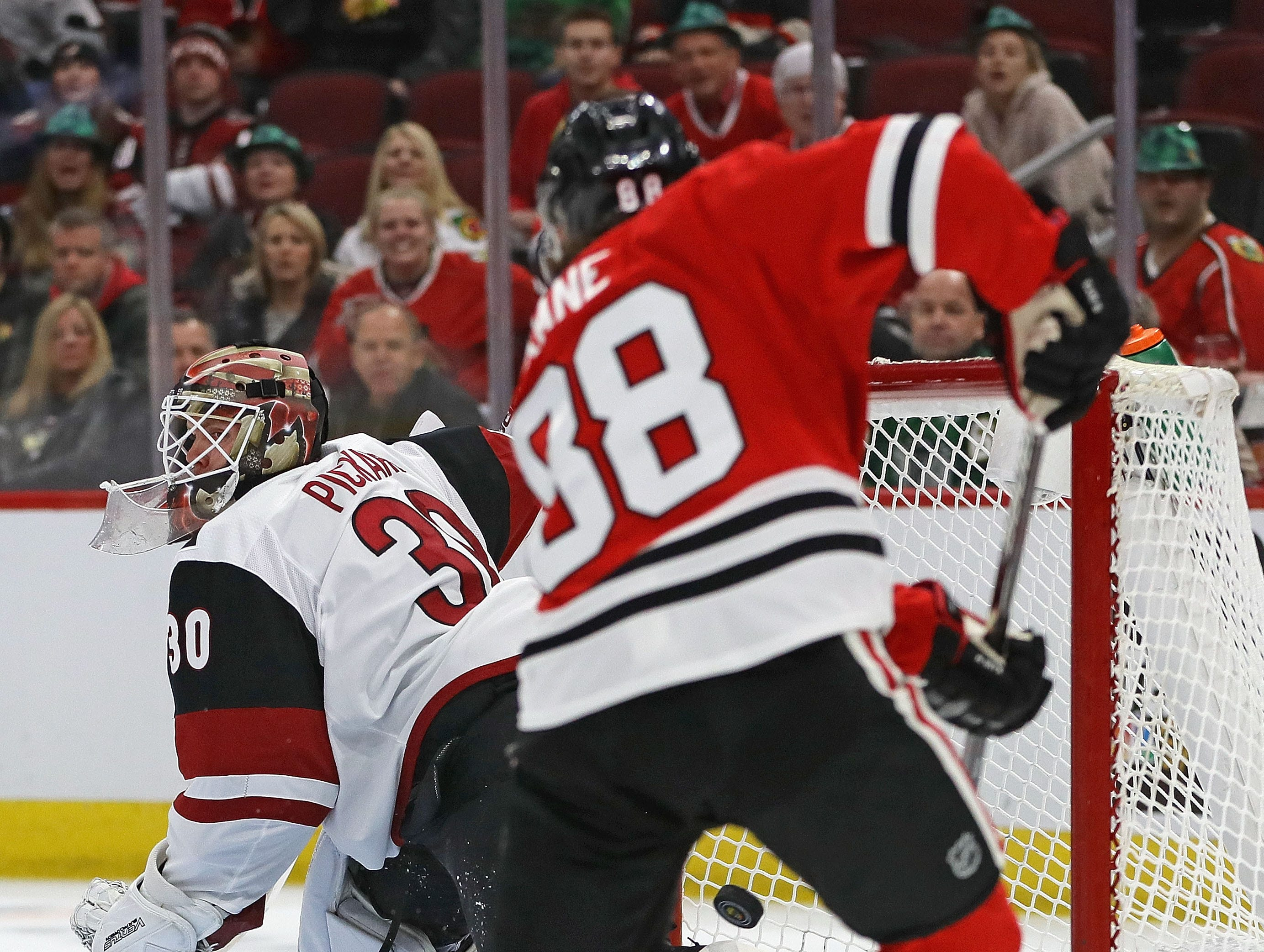 Blackhawks right wing Patrick Kane pushes the puck past Coyotes goaltender Calvin Pickard for a goal in the second period of a game March 11 at the United Center.