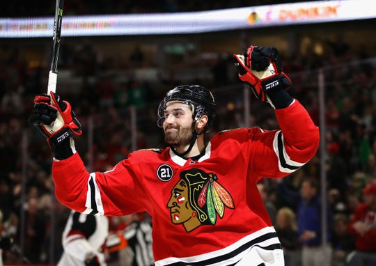 Blackhawks left wing Brendan Perlini celebrates his second goal of the game against the Coyotes on March 11 at the United Center.