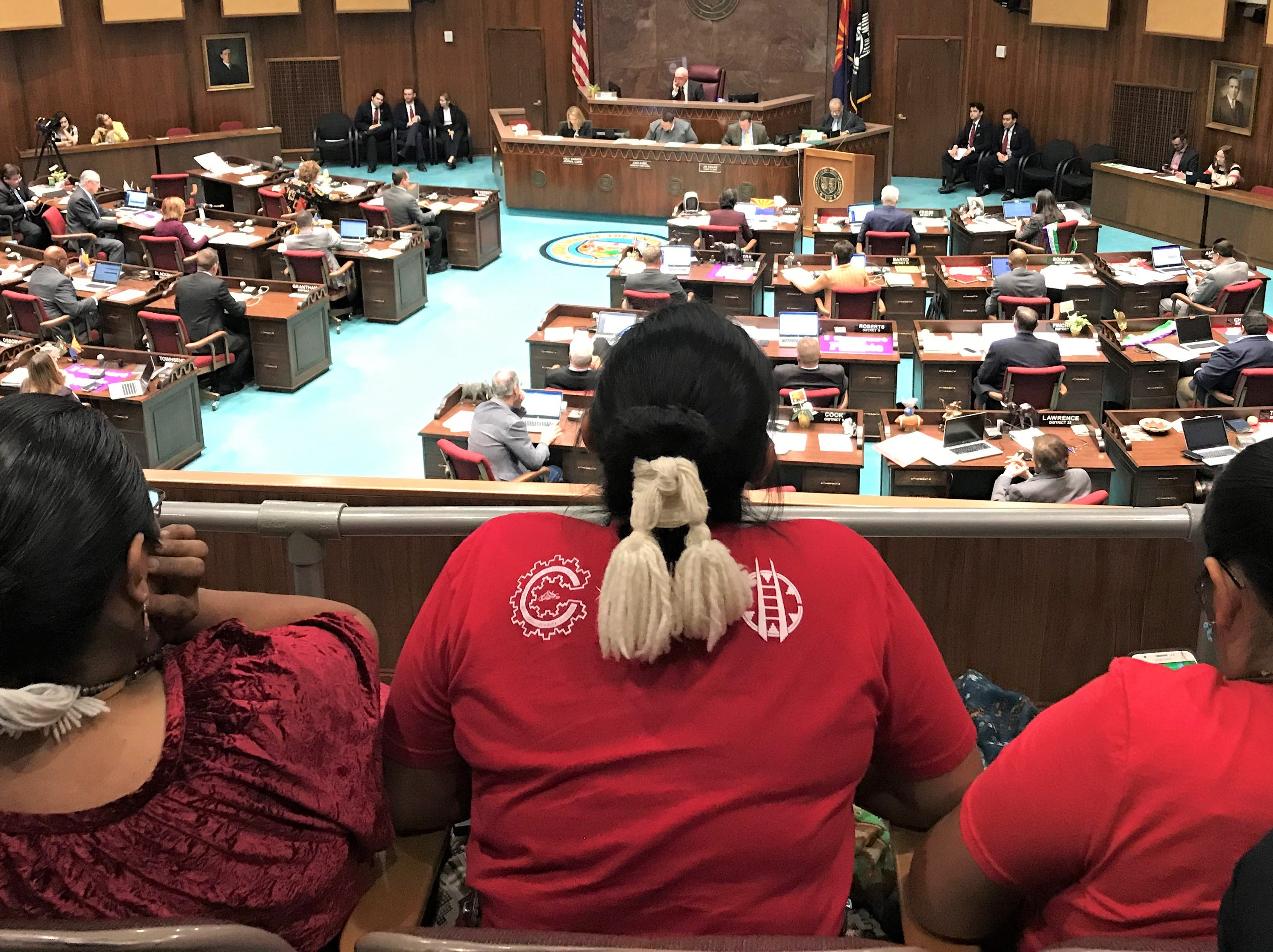 Debbie Nez Manuel (left) sits next to her two daughters sat in the gallery overlooking the House of Representatives on Monday, March 11, 2019. They waited over four hours before HB2570 was voted on. The bill passed with a 60-0 vote.