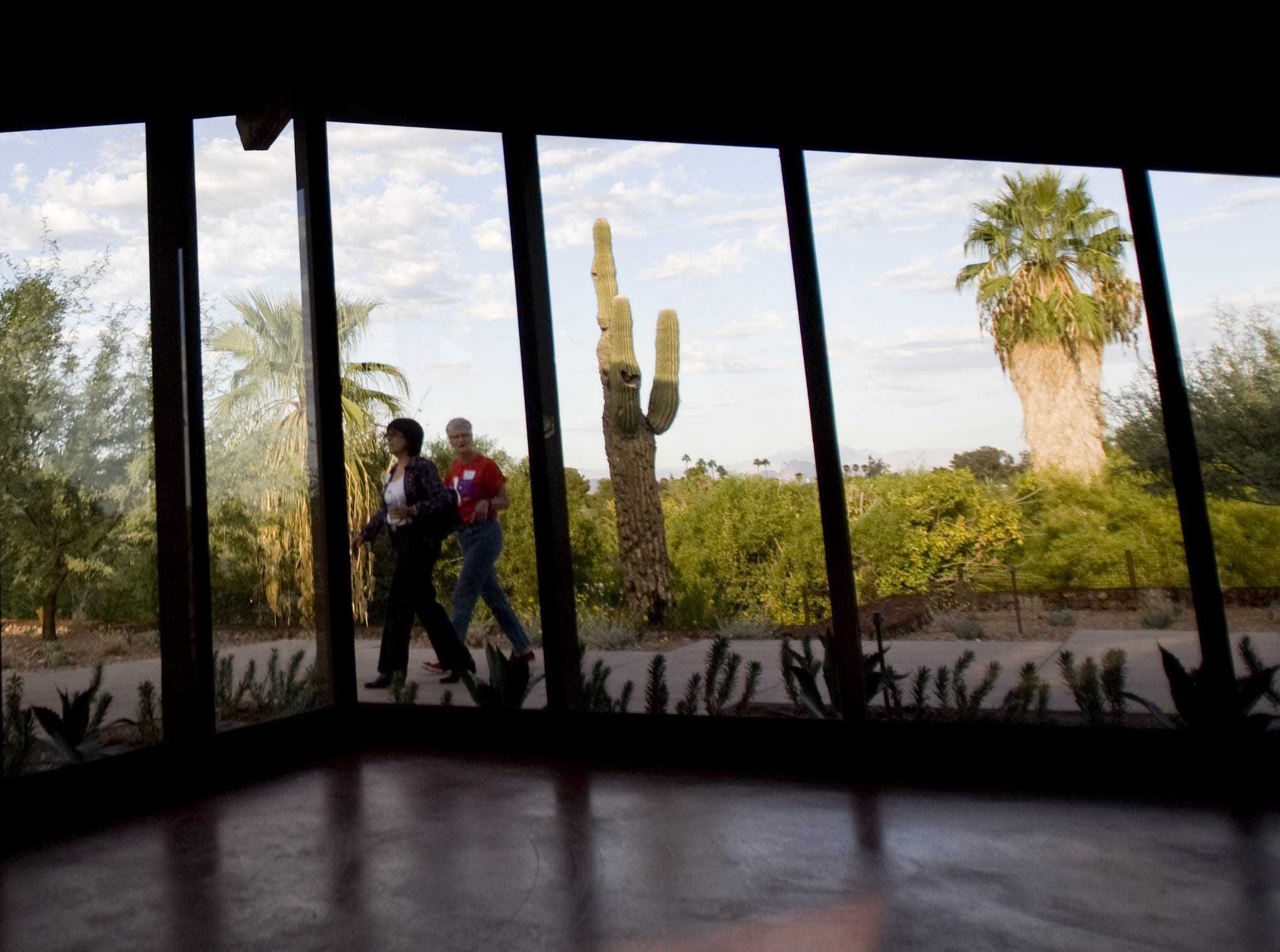 Guests admire Sandra Day O'Connor's house at Papago Park on Oct. 18, 2009.  Her family owned the adobe structure in Paradise Valley and conservationist moved the house to Tempe as an exhibit at the Arizona Historical Museum.