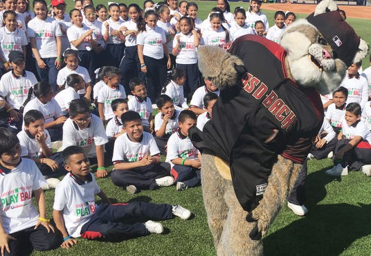 Baxter the Bobcat, the Arizona Diamondbacks team mascot, hams it up for children who participated in a Major League event inside the stadium in Monterrey, Mexico.