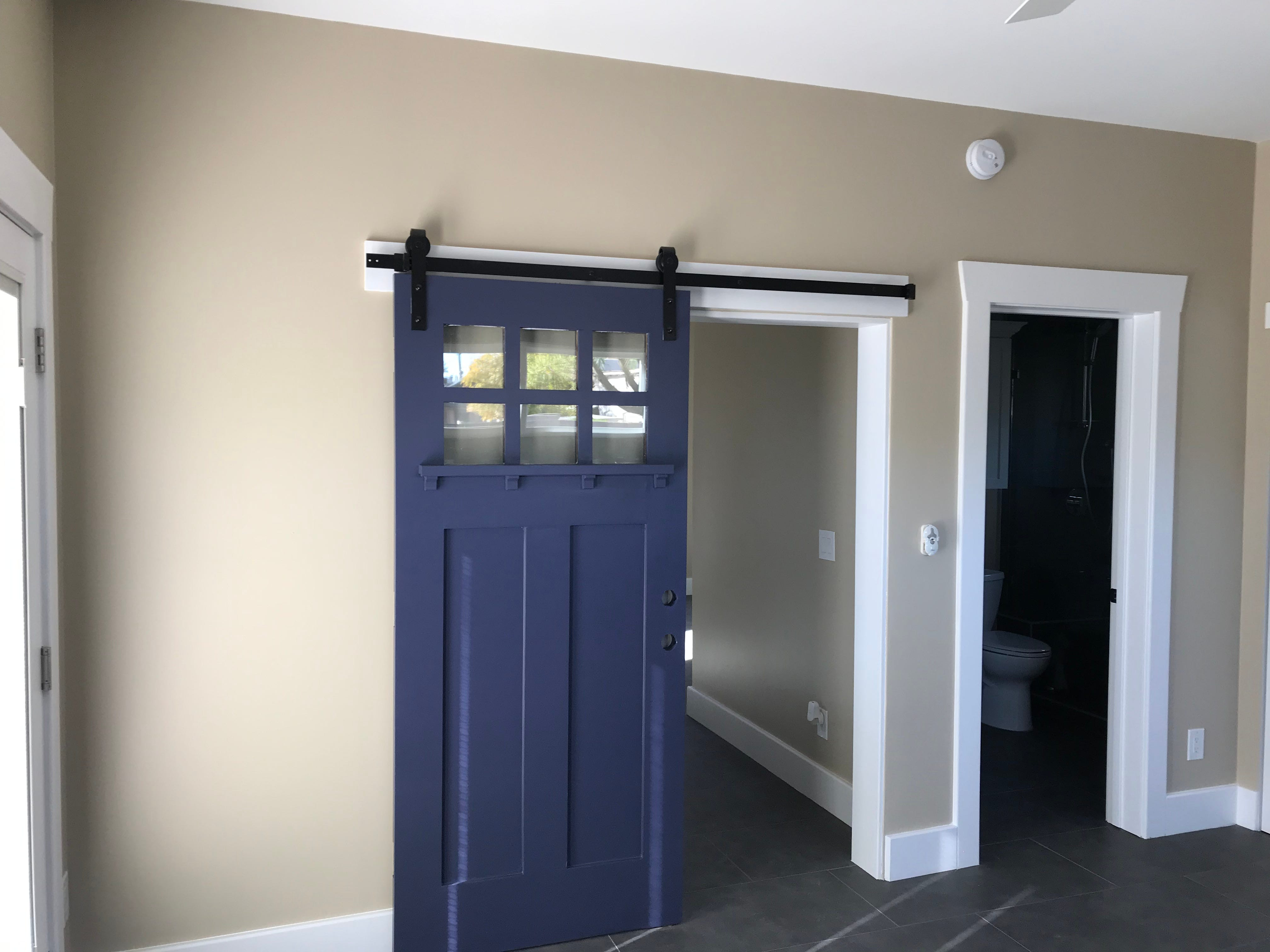 The front door of another home in the neighborhood was salvaged to provide privacy to the guest house bedroom.