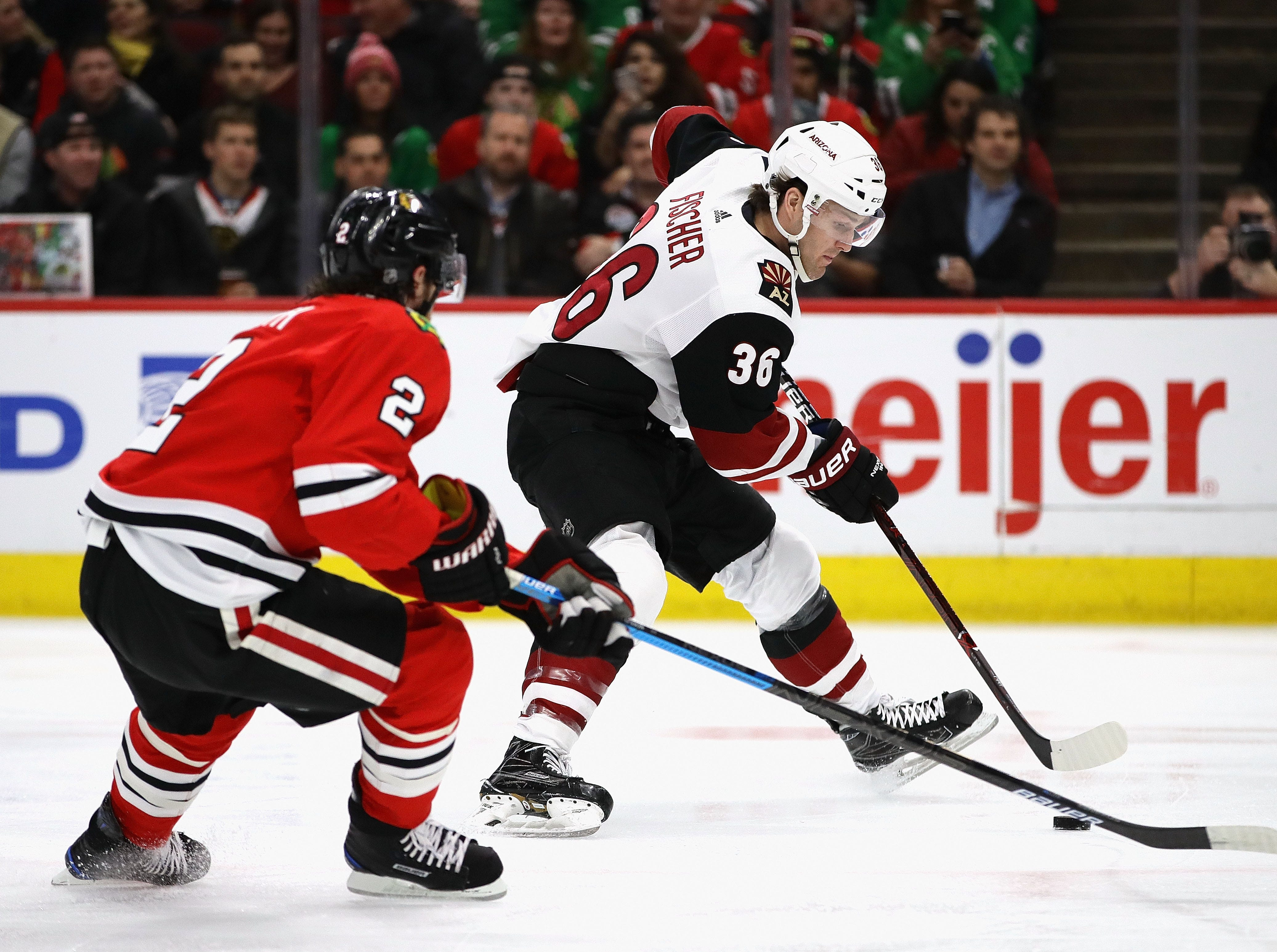 Christian Fischer works with the puck in front of Blackhawks defenseman Duncan Keith during a game March 11 at the United Center.