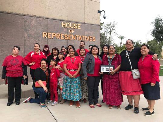 Supporters of HB2570, a bill that would create a study committee focused on missing and murdered indigenous women and girls, pose for a photo outside the House of Representatives on Monday, March 11, 2019. The bill passed with a 60-0 vote.